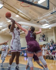 LCA's Bre Porter goes up for a shot against a Vermilion Catholic defender during their Feb. 8 game. Lafayette Christian and Vermilion Catholic will meet again Friday in the Division IV championship.