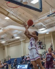 Lafayette Christian's Tamera Johnson (5) goes for the layup as the Lady Knights take on Vermilion Catholic on Friday Feb. 8, 2019.