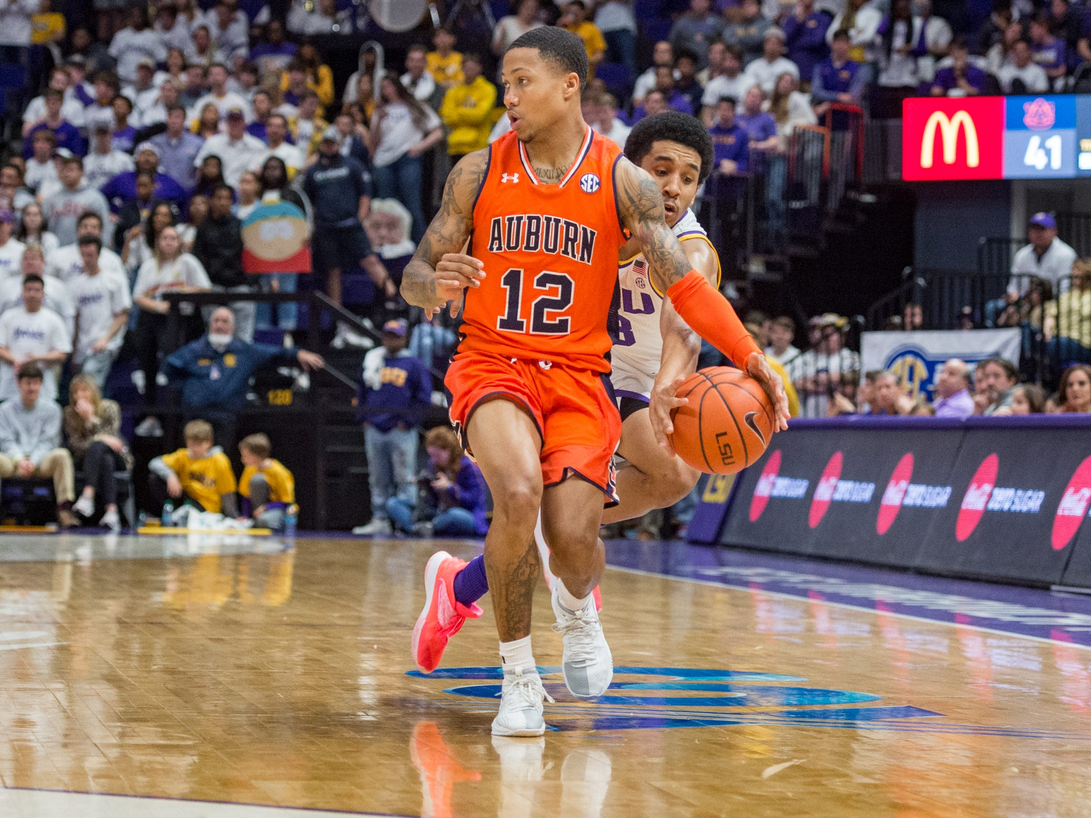 Tremont Waters steals the ball from J'Von McCormick as the LSU Tigers take down the Auburn Tigers 83-78. Saturday, Feb. 9, 2019.