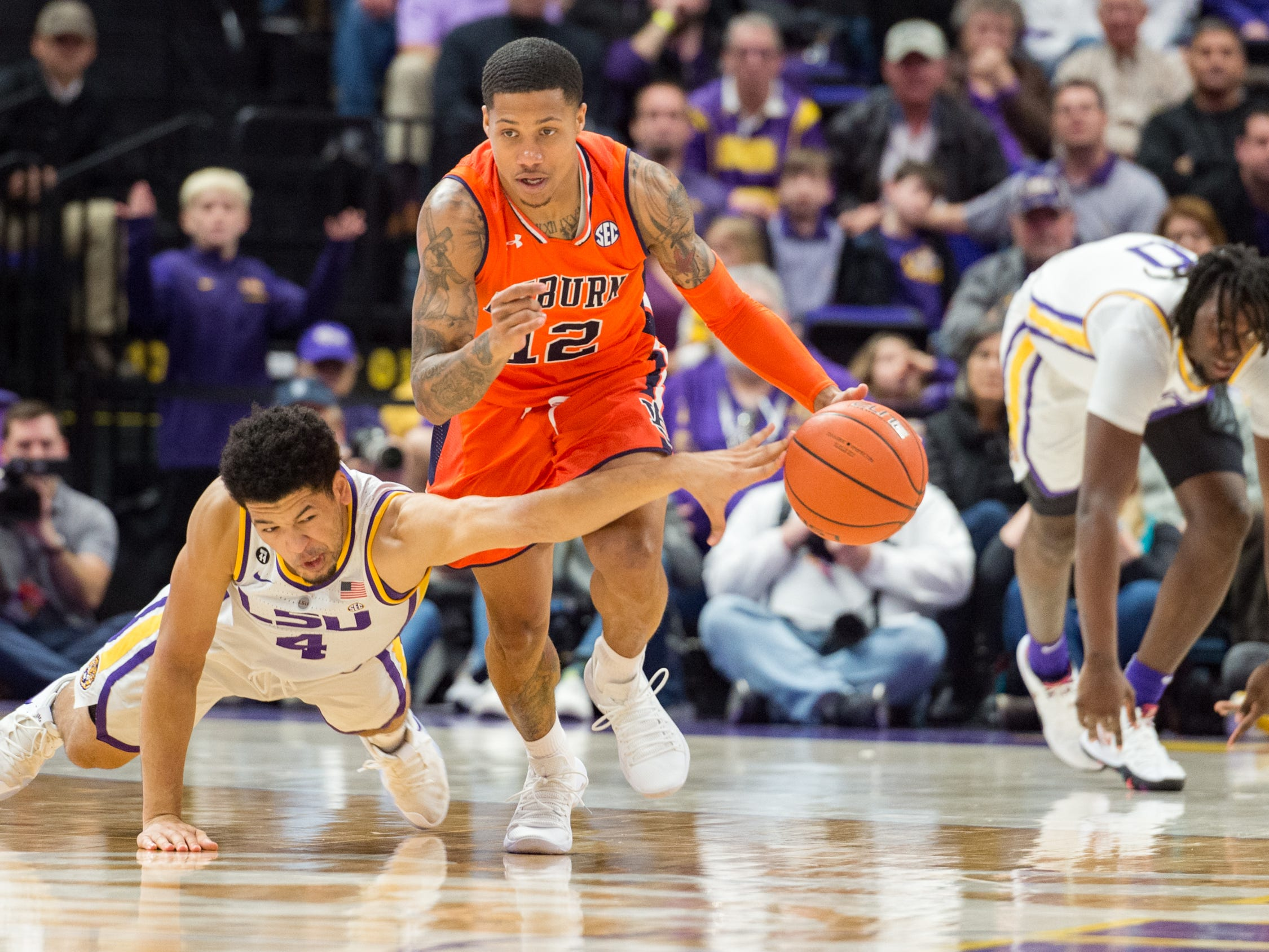 J'Von McCormick drives the ball down court as Skylar mays tries to make a steal as the LSU Tigers take down the Auburn Tigers 83-78. Saturday, Feb. 9, 2019.