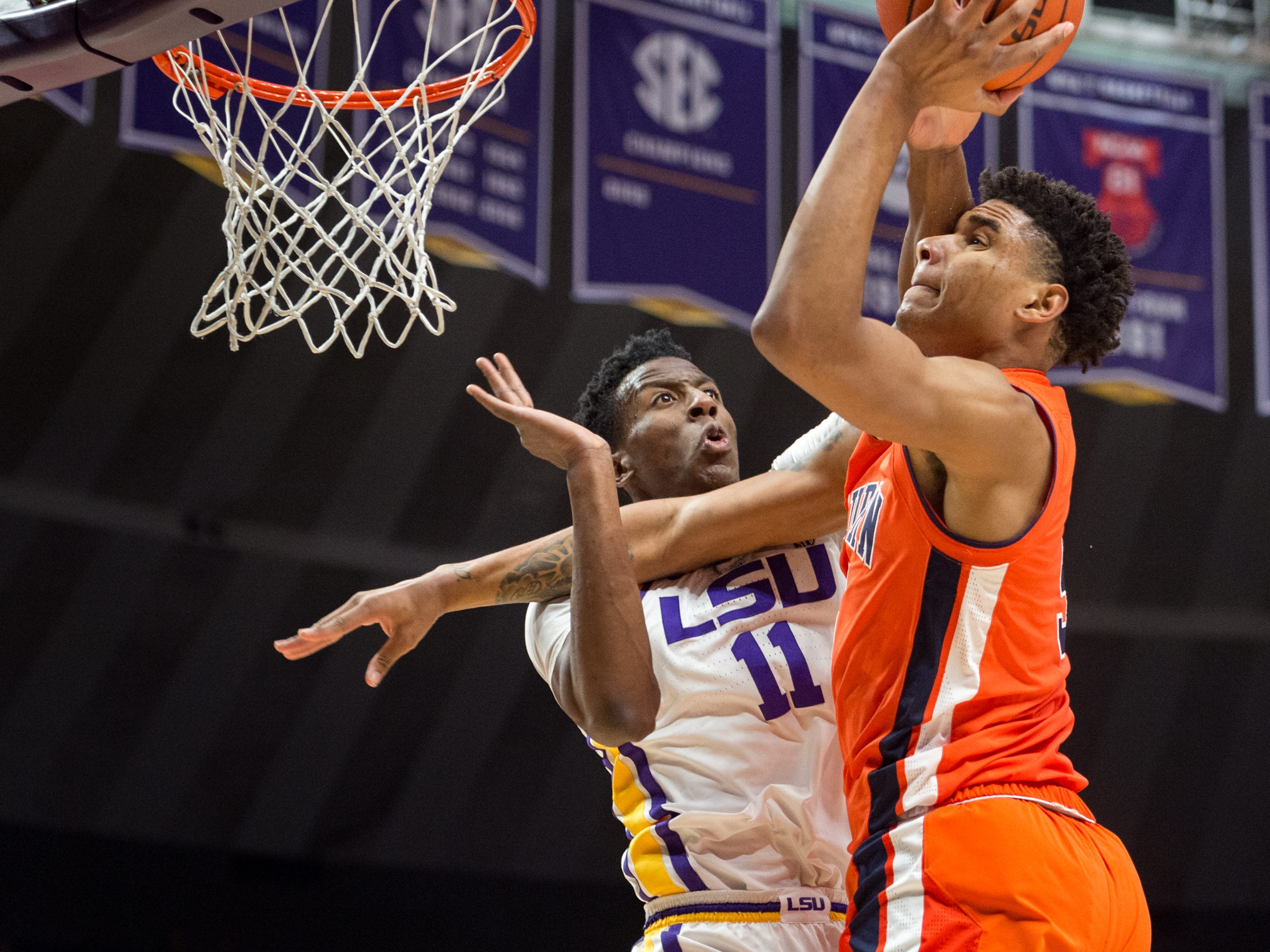 Chuma Okeke takes a shot over Kavell Bigby-Williams as the LSU Tigers take down the Auburn Tigers 83-78. Saturday, Feb. 9, 2019.
