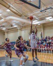Lafayette Christian's Ajaych Simpson (13) goes for the layup as the Lady Knights take on Vermilion Catholic on Friday Feb. 8, 2019.