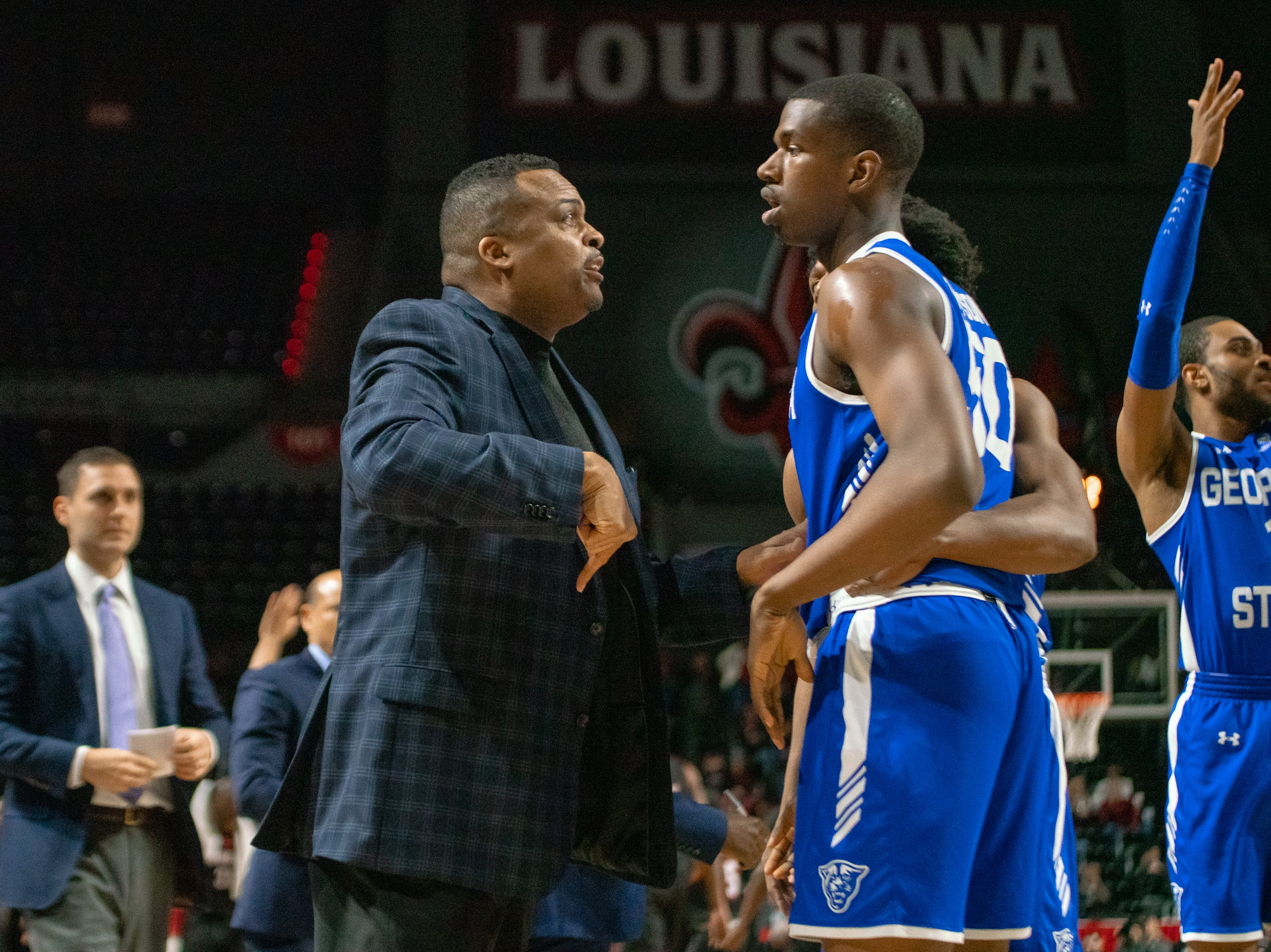 Georgia State's head basketball coach Ron Hunter talks to a player during a time-out as the Ragin' Cajuns take on the Georgia State Panthers at the Cajundome on Feb. 8, 2019.