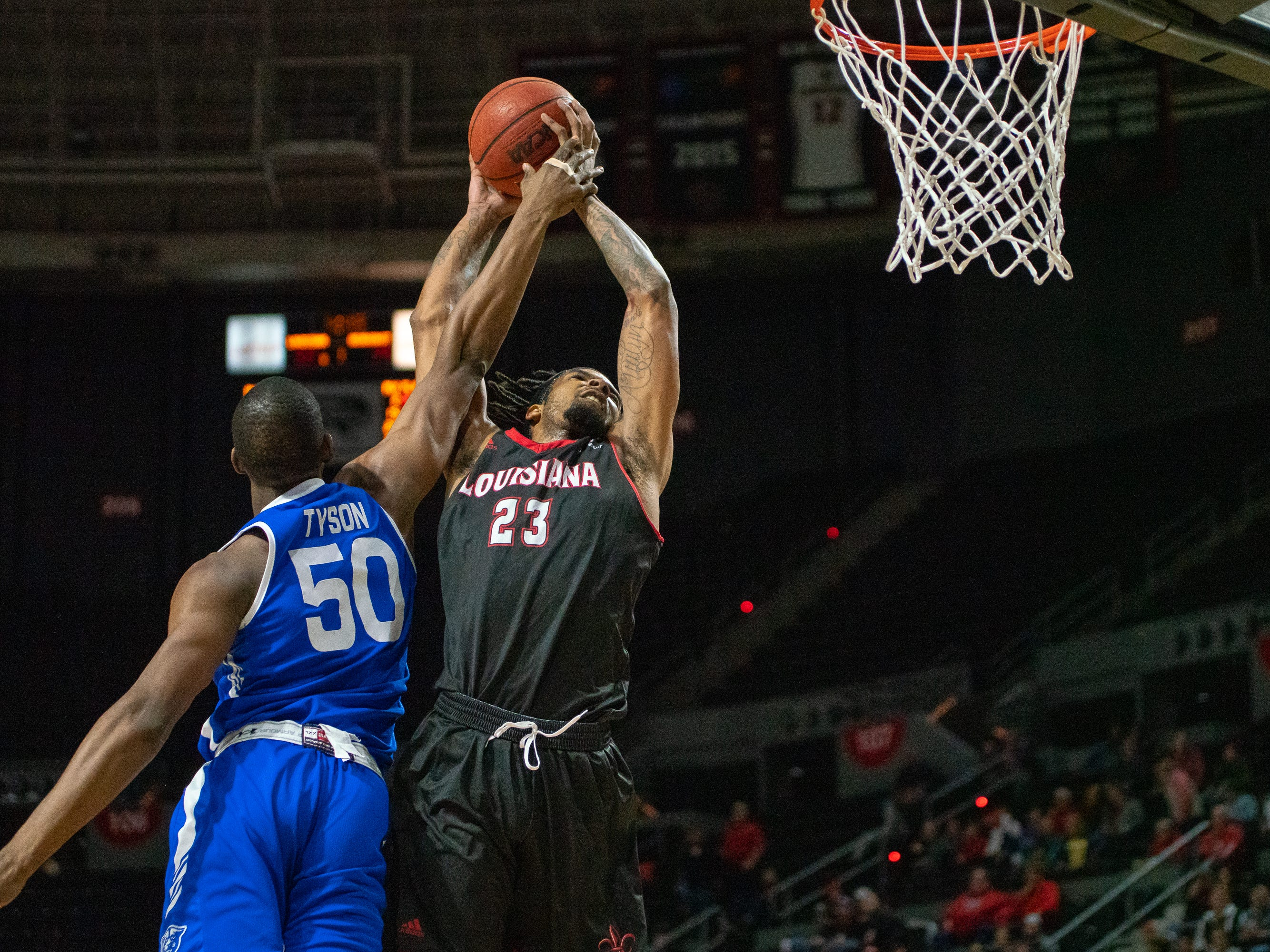 UL's Jakeenan Gant gets foulded while going up to the goal as the Ragin' Cajuns take on the Georgia State Panthers at the Cajundome on Feb. 8, 2019.