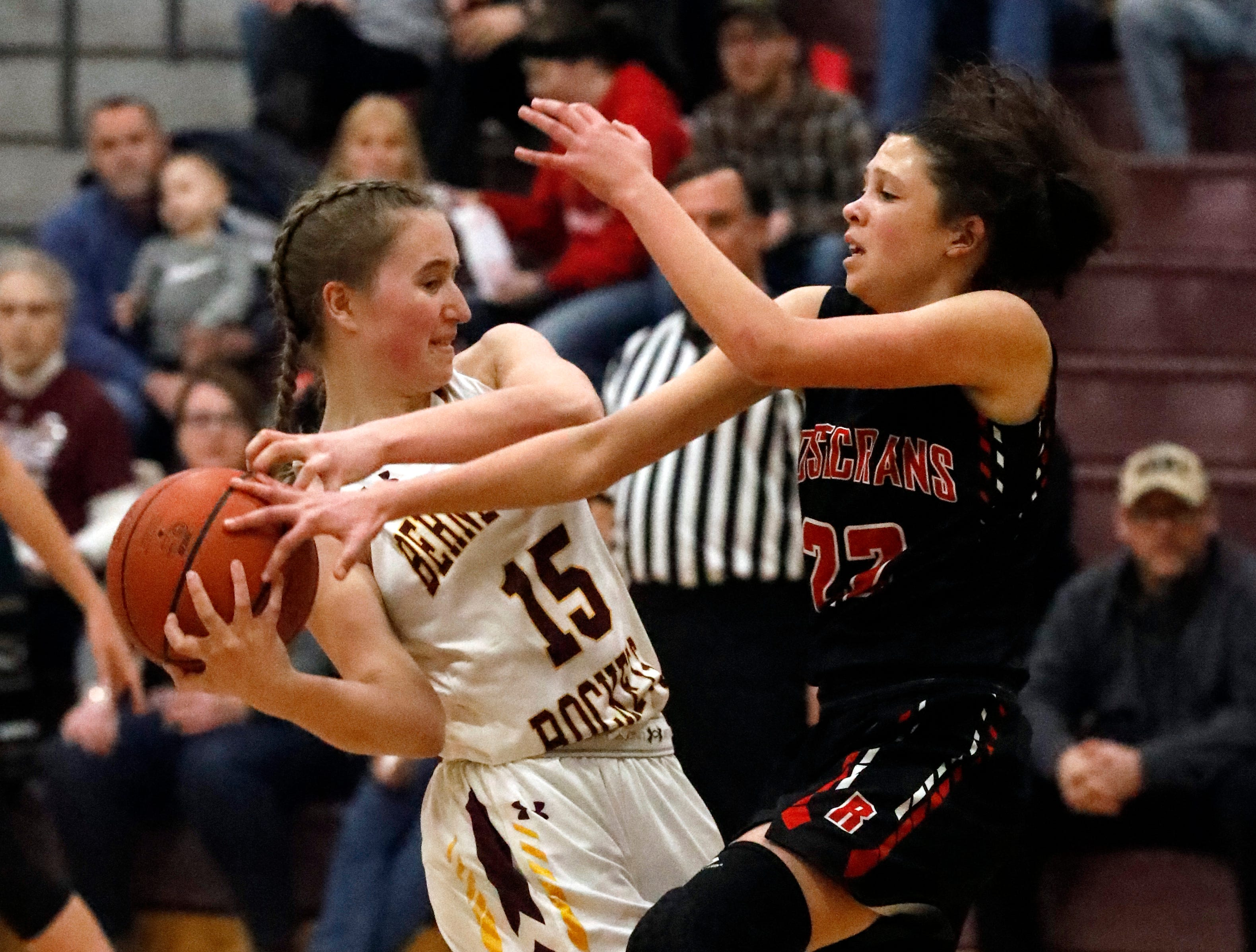 Berne Union's Emily Blevins tries to keep the ball away from Bishop Rosecrans' Jenna Carlisle during Friday night's game, Feb. 8, 2019, at Berne Union High School in Sugar Grove. The Rockets lost the game 46-43.