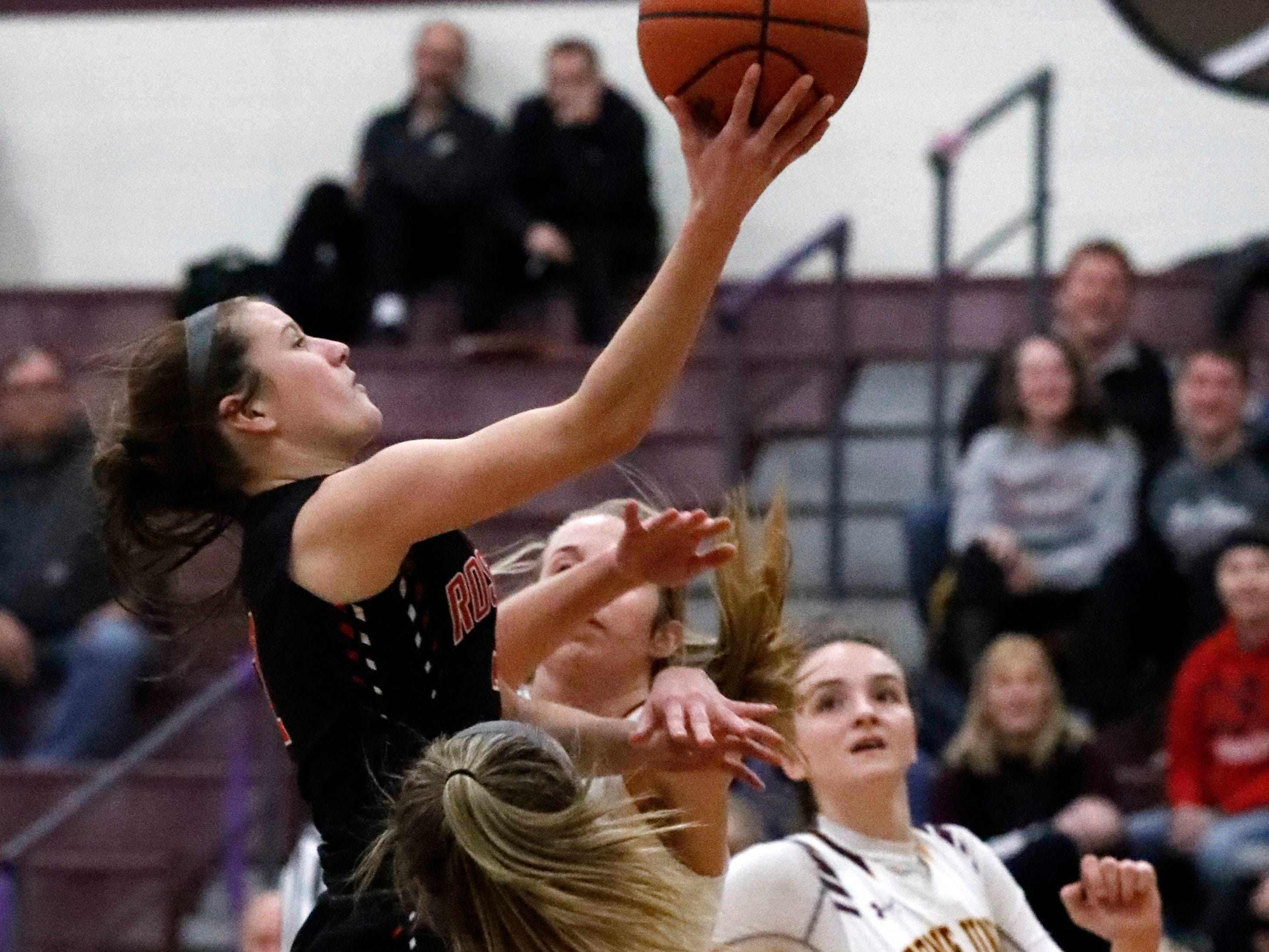 Bishop Rosecrans' Kailey Zemba goes for a layup during Friday night's game, Feb. 8, 2019, at Berne Union High School in Sugar Grove. The Bishops defeated the Rockets 46-43.
