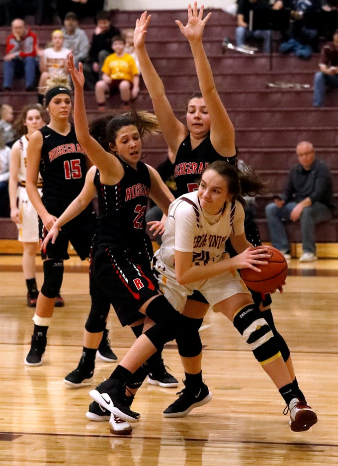 Berne Union's Bella Kline looks for an open teammate as she's guarded by Bishop Rosecrans' Jenna Carlisle, left, and Maggie Hutcheson Friday night, Feb. 8, 2019, at Berne Union High School in Sugar Grove. The Rockets lost the game 46-43.