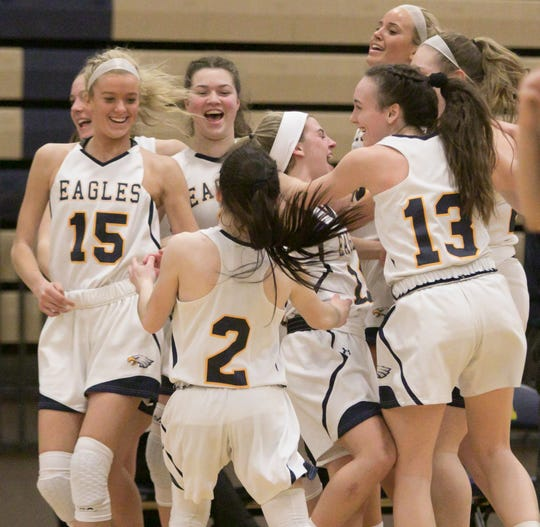Hartland basketball players celebrate a 46-35 victory over previously unbeaten Brighton on Friday, Feb. 8, 2019.