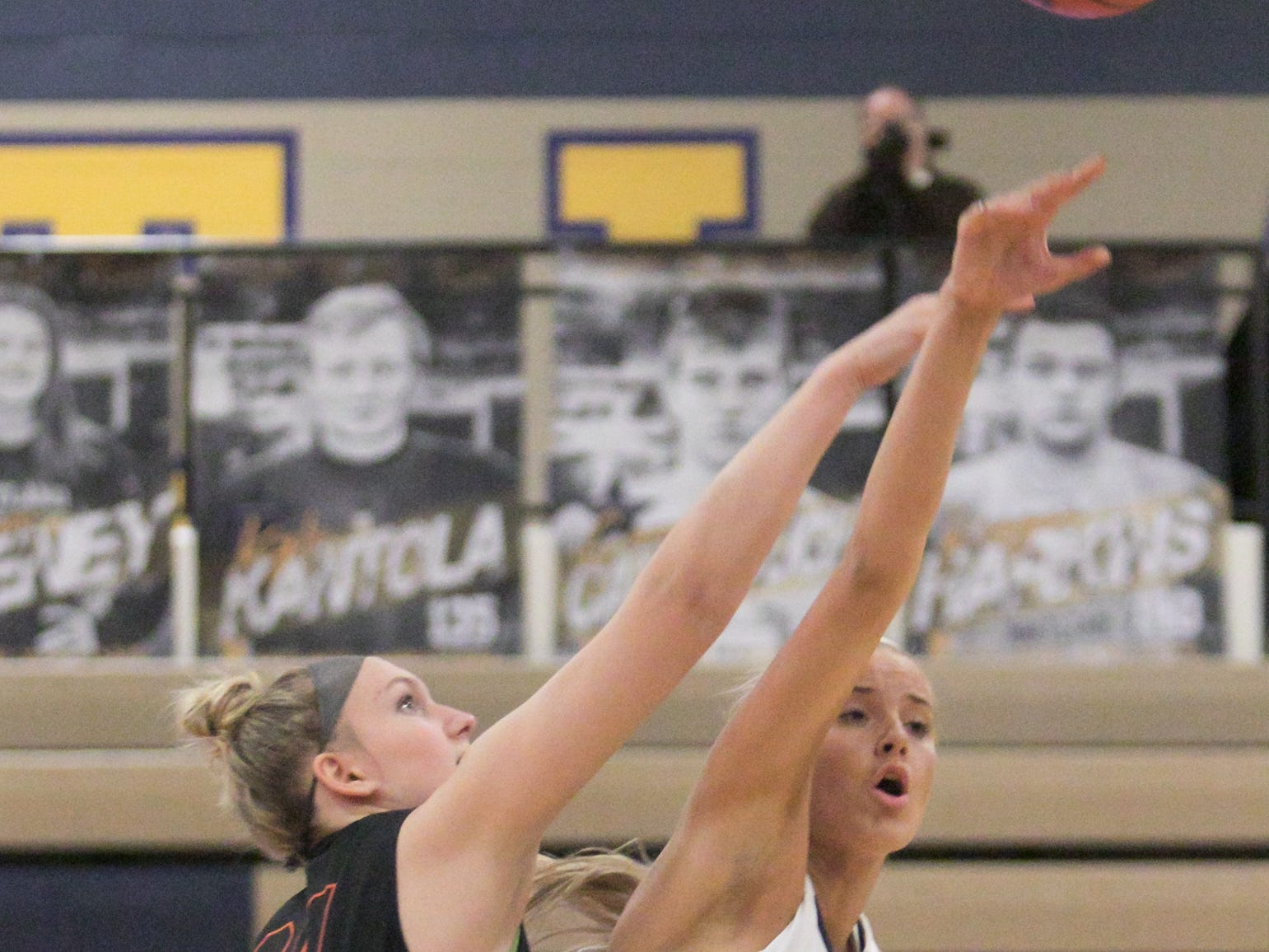 Brighton's Sophie Dziekan (left) and Hartland's Whitney Sollom battle for the opening tip on Friday, Feb. 8, 2019.