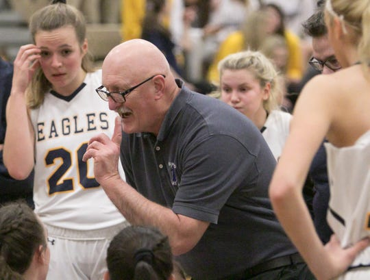 Hartland coach Don Palmer gives direction going into the fourth quarter of a basketball game against Brighton Friday, Feb. 8, 2019.