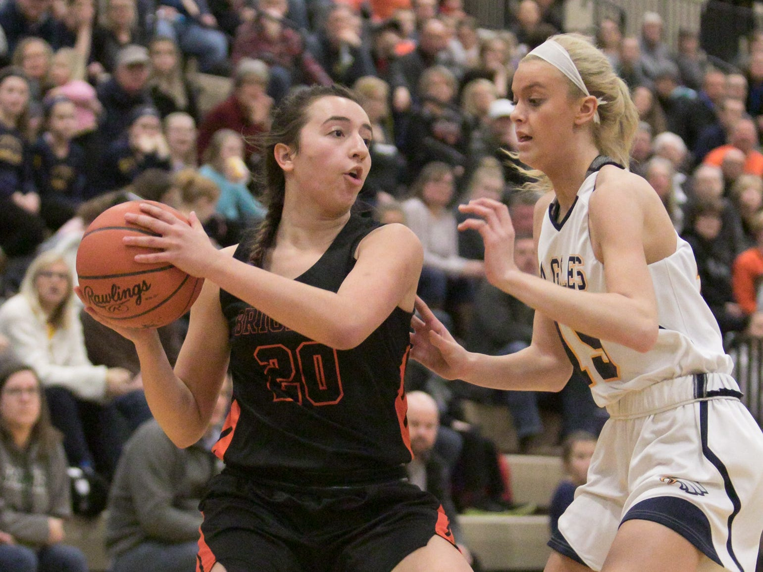 Isabella Viau of Brighton looks to pass, guarded by Hartland's Whitney Sollom in the game at Hartland Friday, Feb. 8, 2019.