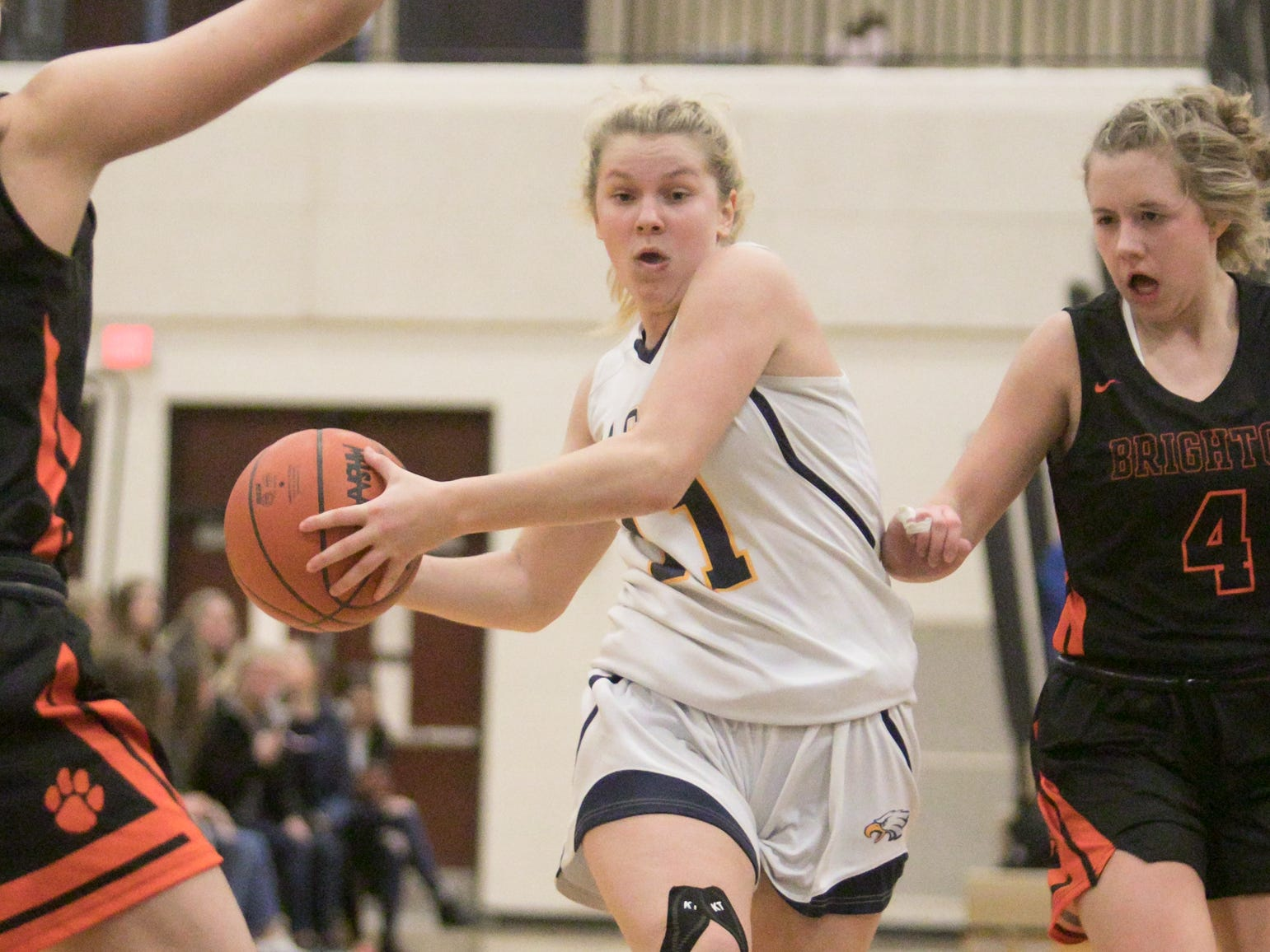 Hartland's Amanda Roach drives for two of her game-high 13 points while being chased by Brighton's Bella Vogt on Friday, Feb. 8, 2019.
