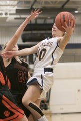 Nikki Dompierre of Hartland scores two of her 12 points while defended by Brighton's Martha Pietila on Friday, Feb. 8, 2019.