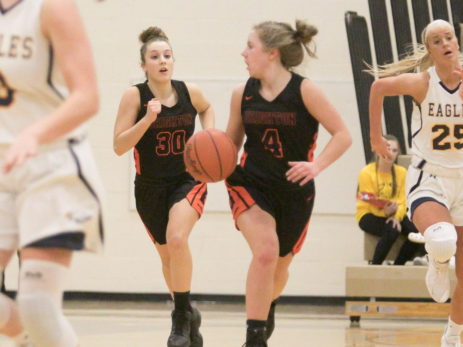 Bella Vogt of Brighton brings the ball in play along with Lauren Brown in the game at Hartland Friday, Feb. 8, 2019.