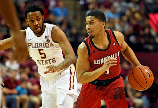 Louisville Cardinals guard Christen Cunningham (1) drives the ball against Florida State Seminoles guard PJ Savoy (5) during the first half at Donald L. Tucker Center in Tallahassee, Florida, on Saturday, Feb. 9, 2019.