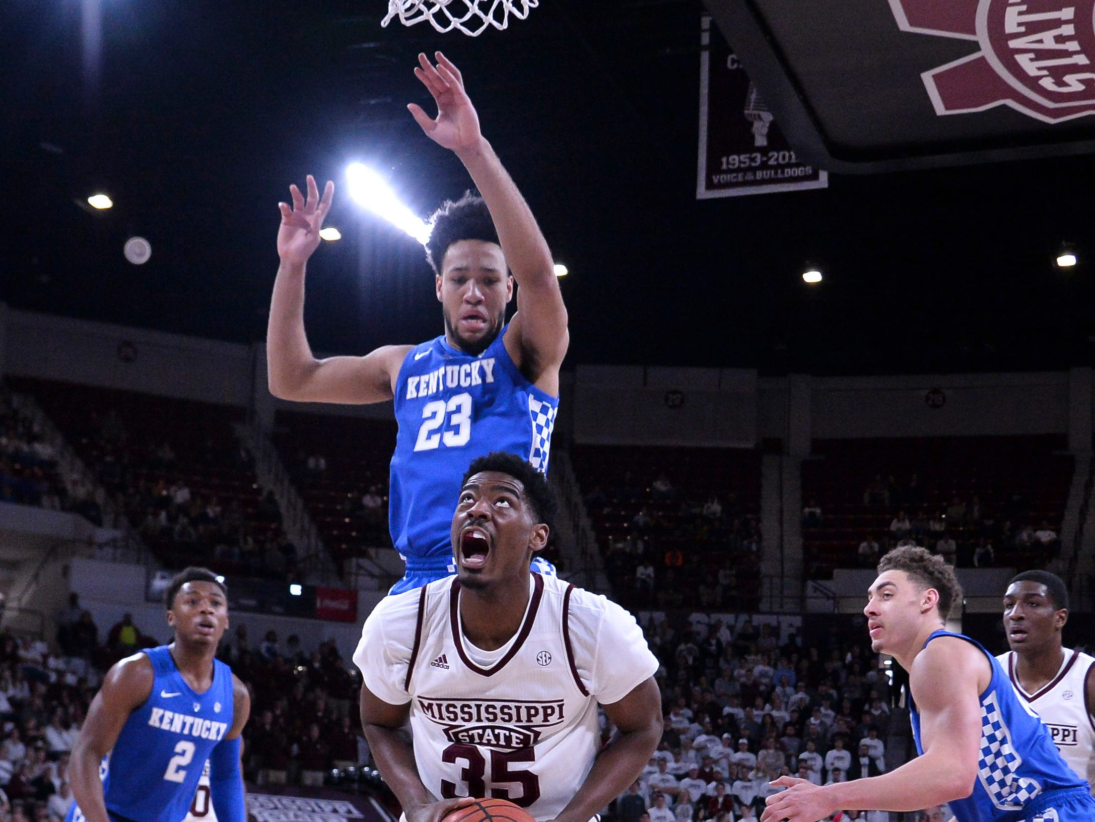 Mississippi State Bulldogs forward Aric Holman (35) handles the ball while being defended by Kentucky Wildcats forward EJ Montgomery (23) during the first half at Humphrey Coliseum in Starkville, Mississippi, on Saturday, Feb. 9, 2019.