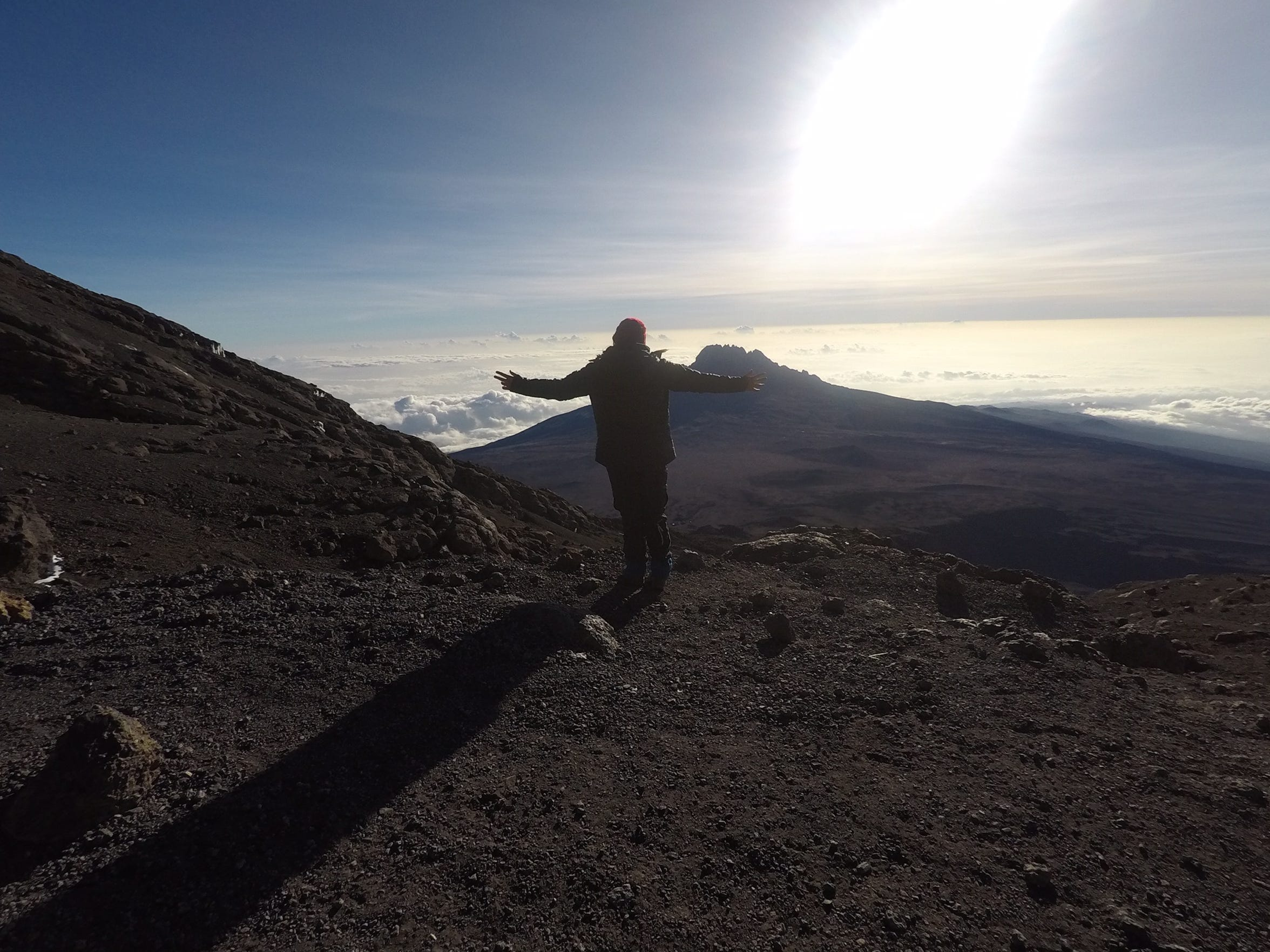 A moment of peace at the summit of Mount Kilimanjaro, Tanzania