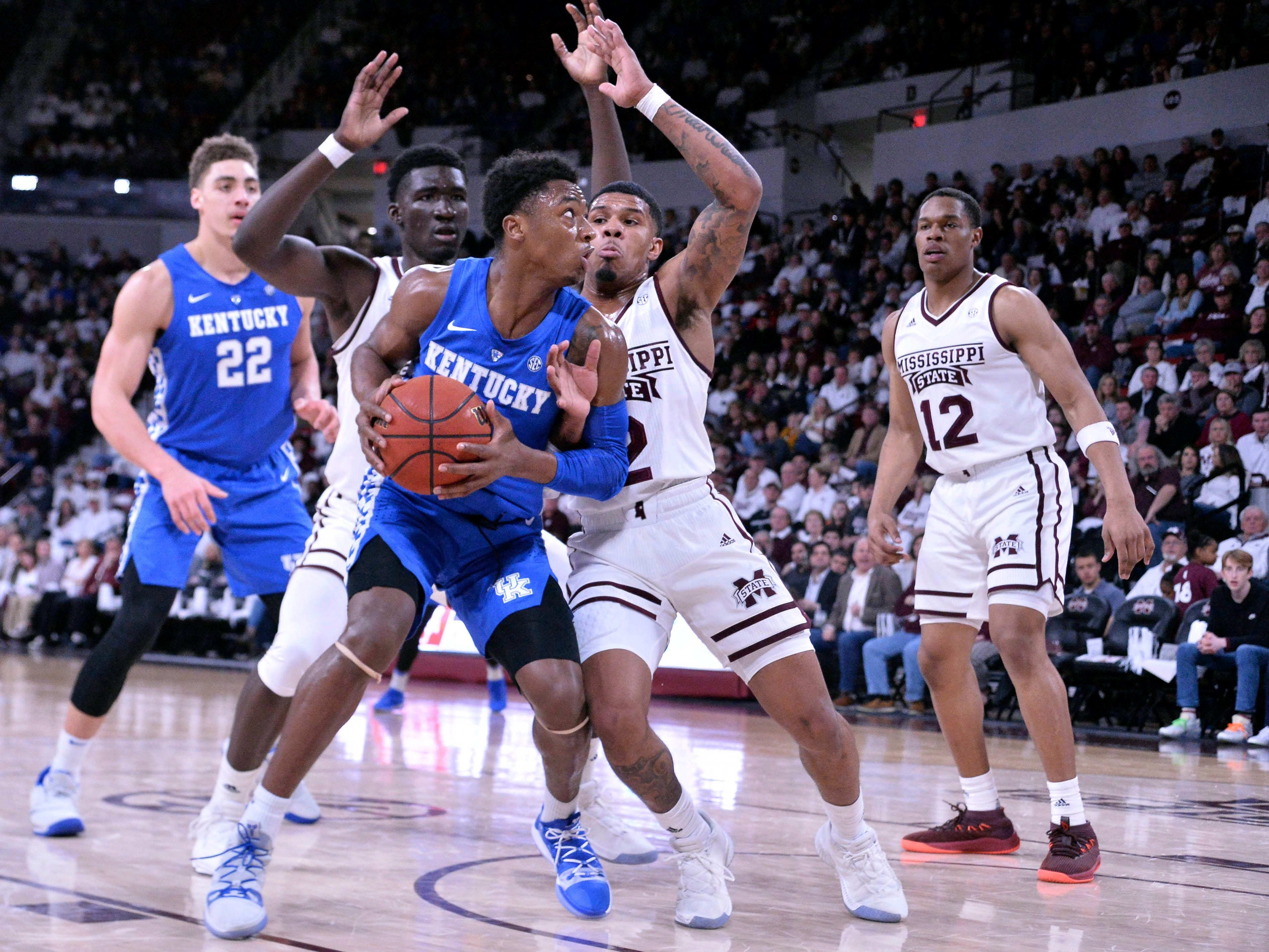 Kentucky Wildcats guard Ashton Hagans (2) handles the ball while being defended by Mississippi State Bulldogs forward Abdul Ado (24) and guard Lamar Peters (2) during the first half at Humphrey Coliseum in Starkville, Mississippi, on Saturday, Feb. 9, 2019.