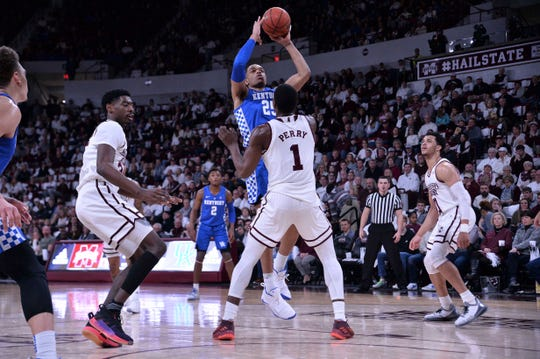 Kentucky Wildcats forward PJ Washington (25) goes up for a shot over Mississippi State Bulldogs forward Reggie Perry (1) during the first half at Humphrey Coliseum in Starkville, Mississippi, on Saturday, Feb. 9, 2019.