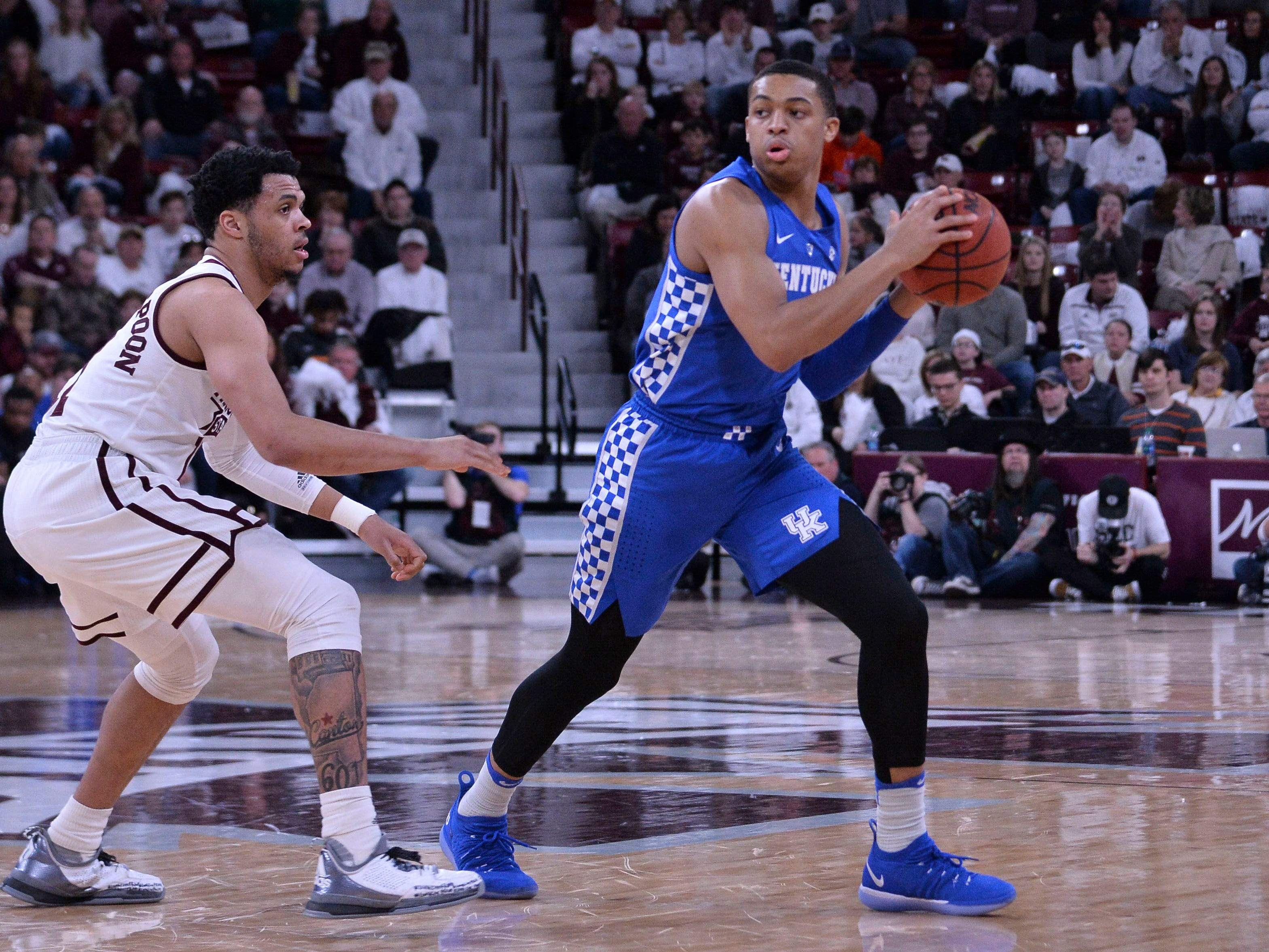 Kentucky Wildcats guard Keldon Johnson (3) handles the ball against Mississippi State Bulldogs guard Quinndary Weatherspoon (11) during the first half at Humphrey Coliseum in Starkville, Mississippi, on Saturday, Feb. 9, 2019.