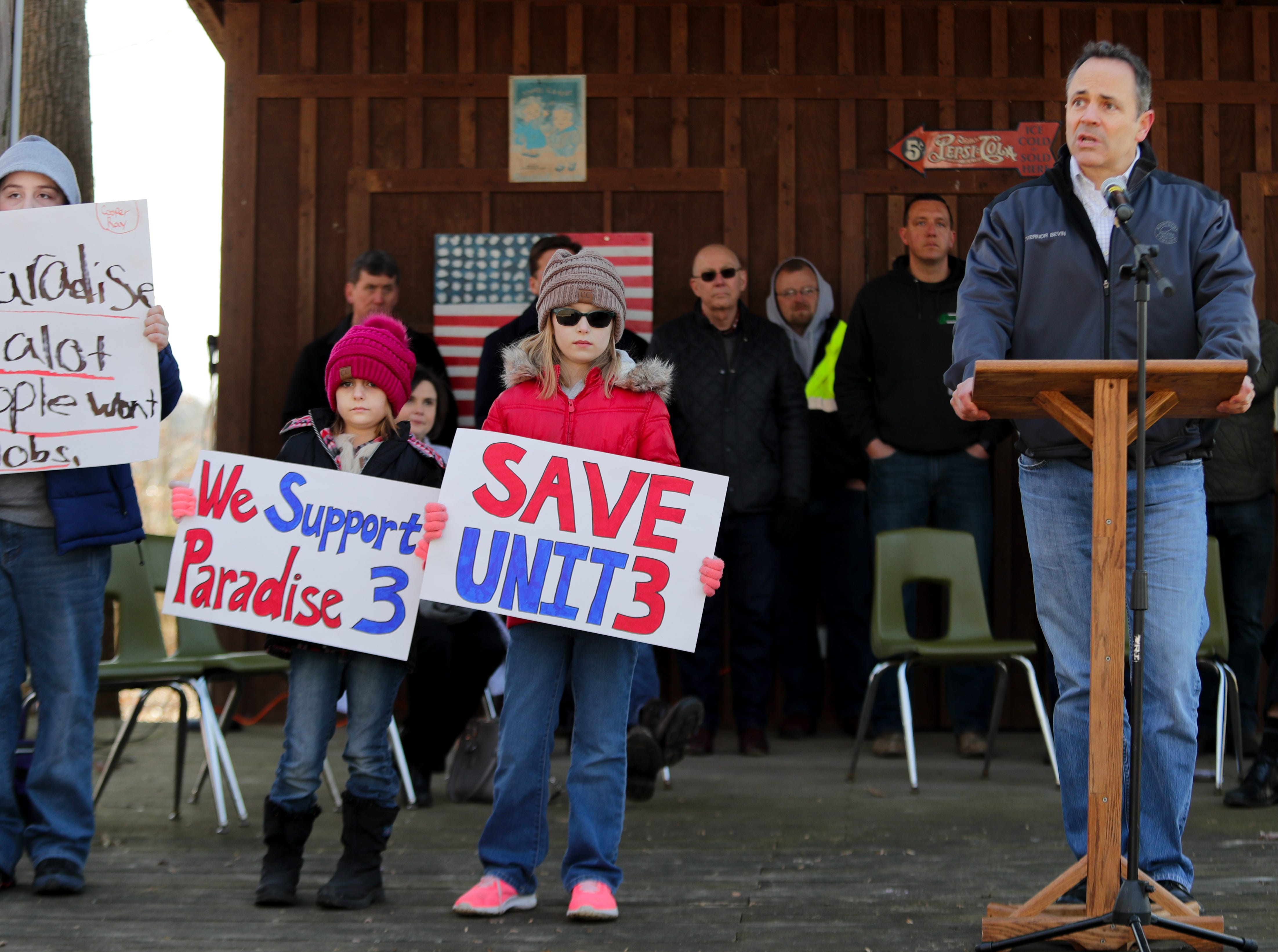Governor Matt Bevin speaks to the crowd after inviting Breanna Coin, center, and Brillee-ann Wilkerson on to stage with him at a rally to save the Paradise Fossil Plant in Muhlenberg County. Feb. 9, 2019