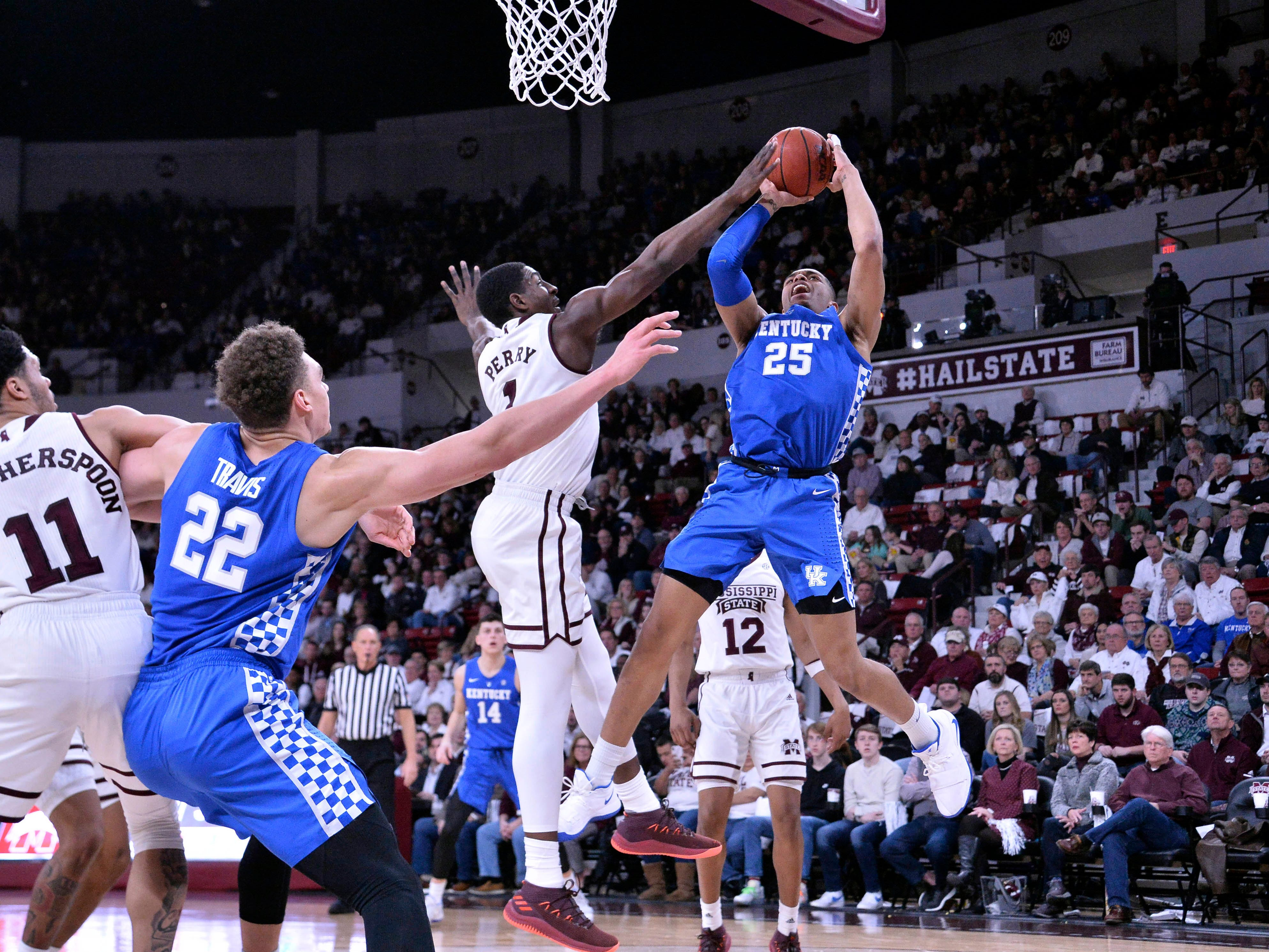 Kentucky Wildcats forward PJ Washington (25) goes up for a shot while being defended by Mississippi State Bulldogs forward Reggie Perry (1) during the first half at Humphrey Coliseum in Starkville, Mississippi, on Saturday, Feb. 9, 2019.