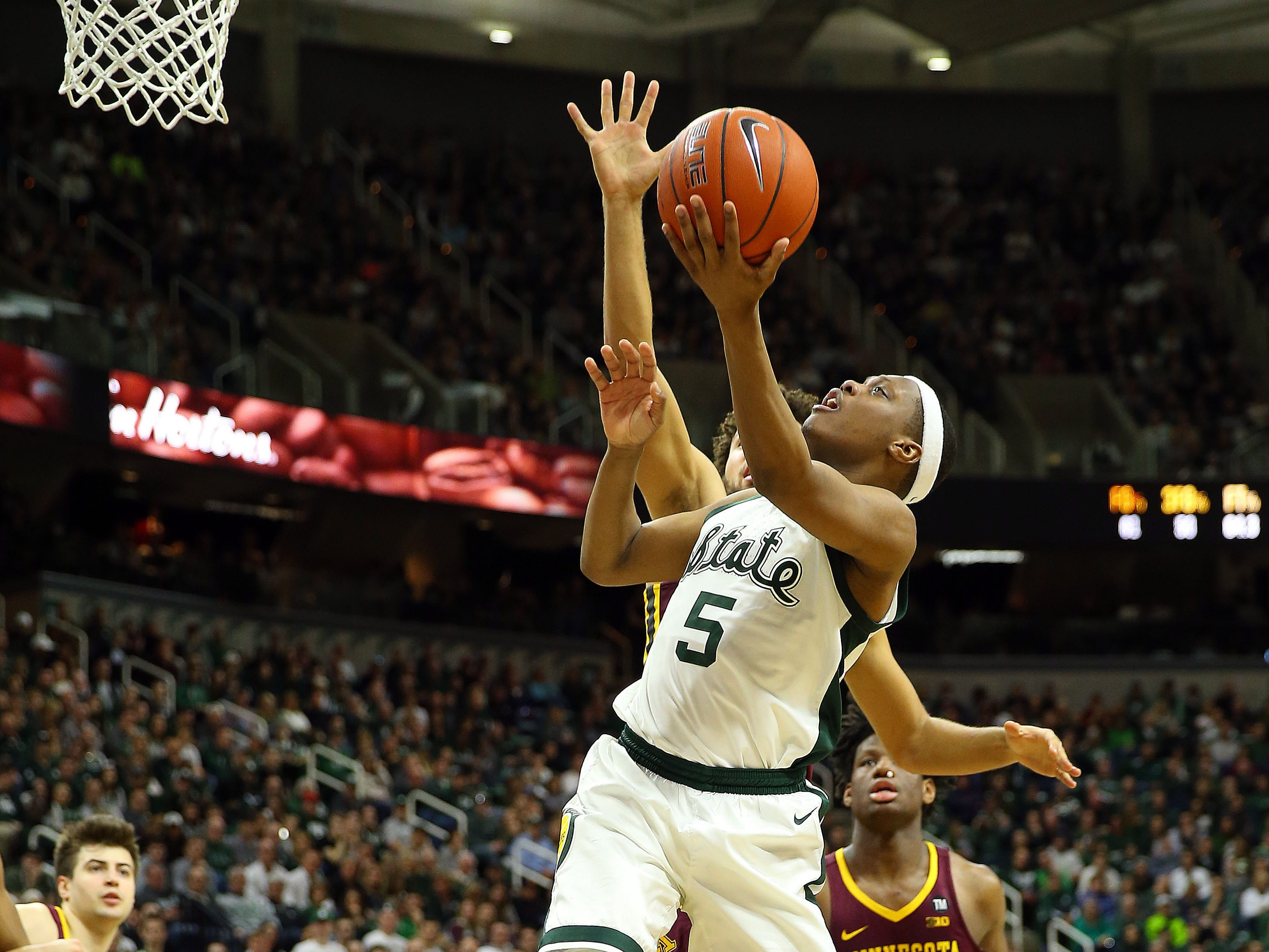Michigan State guard Cassius Winston lays the ball up against Minnesota at the Breslin Center, Feb. 9, 2019.