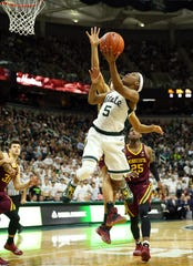 Cassius Winston drives to the basket Saturday.
