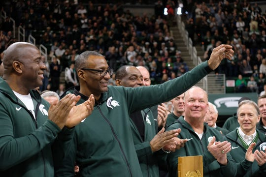 Earvin Johnson, left, and Gregory Kelser from the 1979 MSU National Championship team wave the crowd at Breslin Saturday, Feb. 9, 2019.