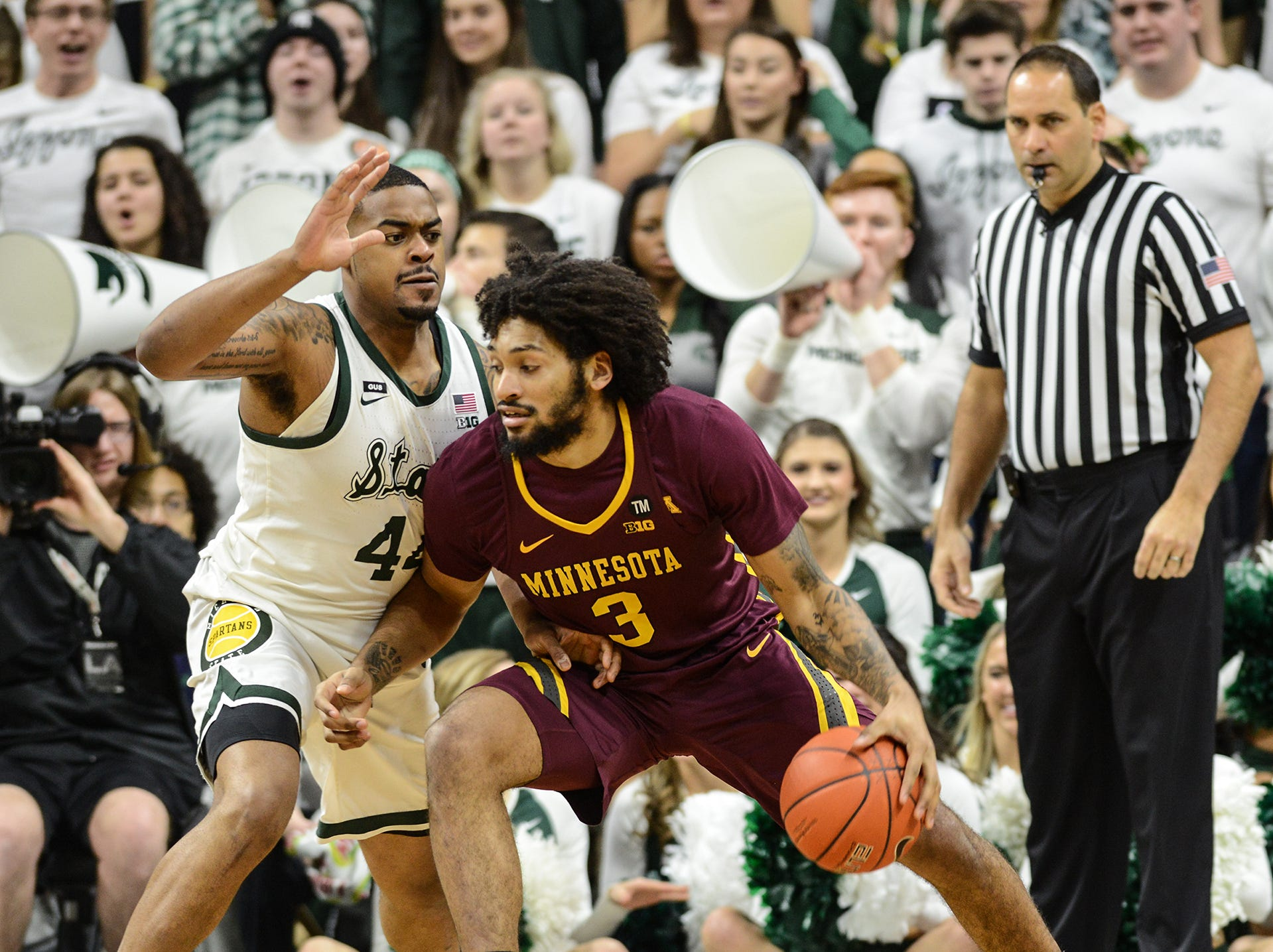 MSU forward Nick Ward (44)guards Minnesota's Jordan Murphy (3) Saturday, Feb. 9, 2019. MSU won 79-55.