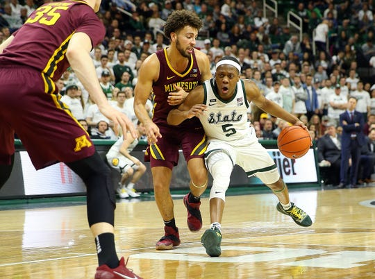Feb 9, 2019; East Lansing, MI, USA; Michigan State Spartans guard Cassius Winston (5) drives the lane against Minnesota Golden Gophers guard Gabe Kalscheur (22) during the second half at the Breslin Center. Mandatory Credit: Mike Carter-USA TODAY Sports