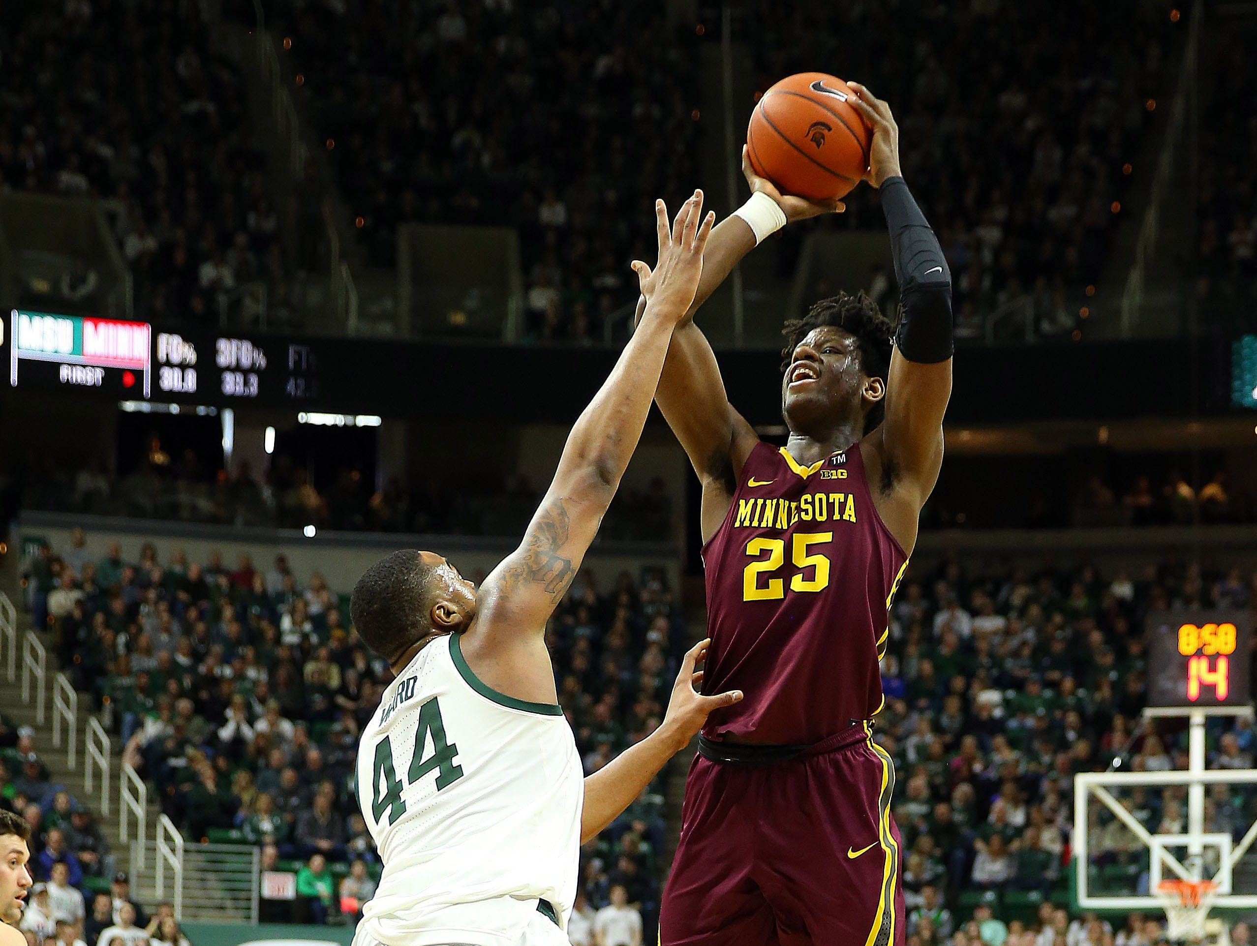 Feb 9, 2019; East Lansing, MI, USA; Minnesota Golden Gophers center Daniel Oturu (25) shoots over Michigan State Spartans forward Nick Ward (44) during the first half at the Breslin Center. Mandatory Credit: Mike Carter-USA TODAY Sports