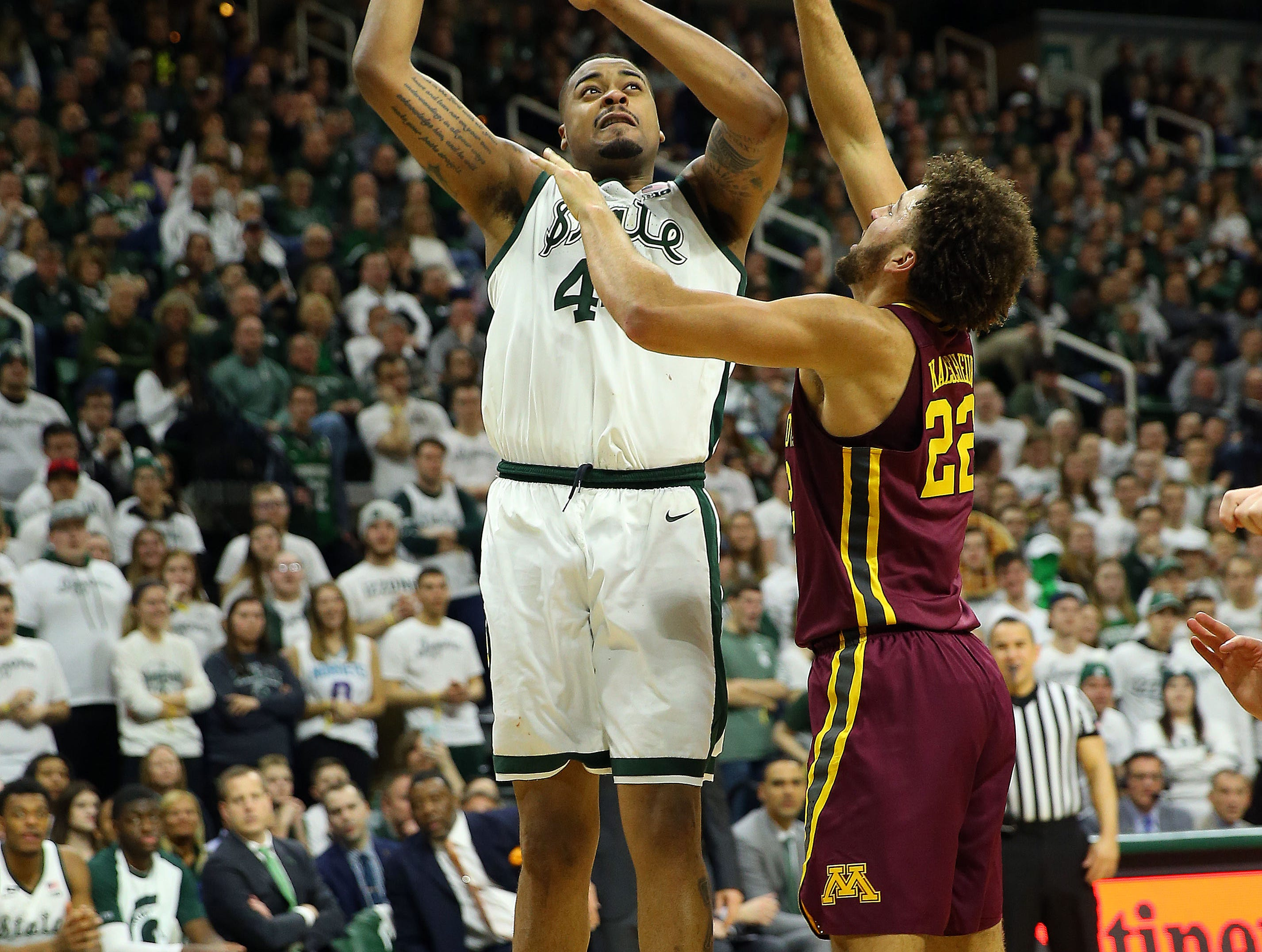 Feb 9, 2019; East Lansing, MI, USA; Michigan State Spartans forward Nick Ward (44) shoots over Minnesota Golden Gophers guard Gabe Kalscheur (22) during the second half at the Breslin Center. Mandatory Credit: Mike Carter-USA TODAY Sports