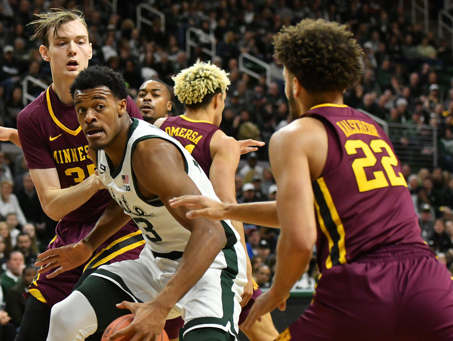 MSU's Xavier Tillman (23) works the ball in against Minnesota's Gabe Kalscheur, (22) at the Breslin Center, Saturday, Feb. 9, 2019.