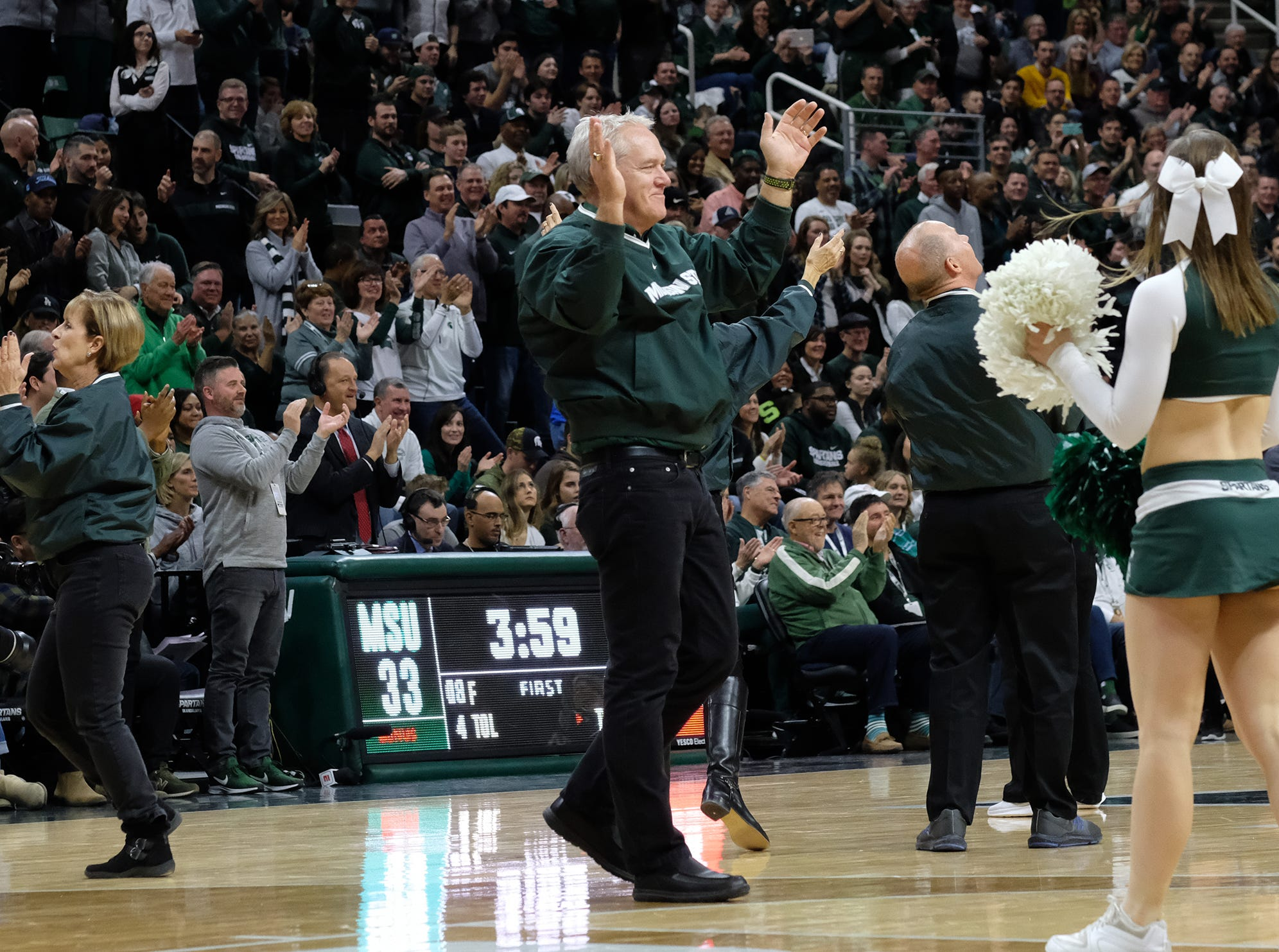 Members of the 1979 MSU cheerleading squad perform at Breslin Center Saturday, Feb. 9, 2019.