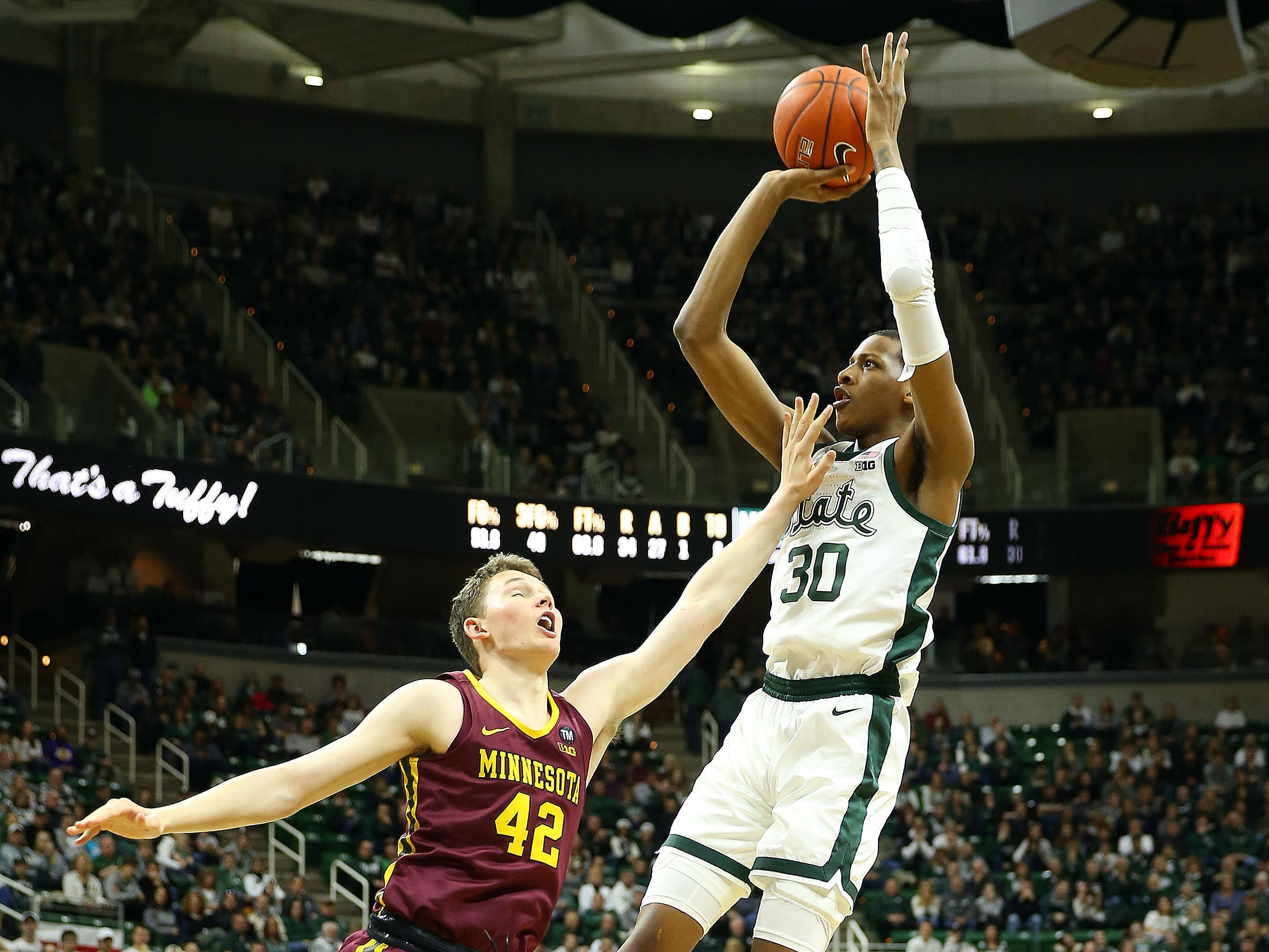 Michigan State's Marcus Bingham Jr. shoots over Minnesota's Michael Hurt during the second half Feb 9, 2019 in East Lansing.