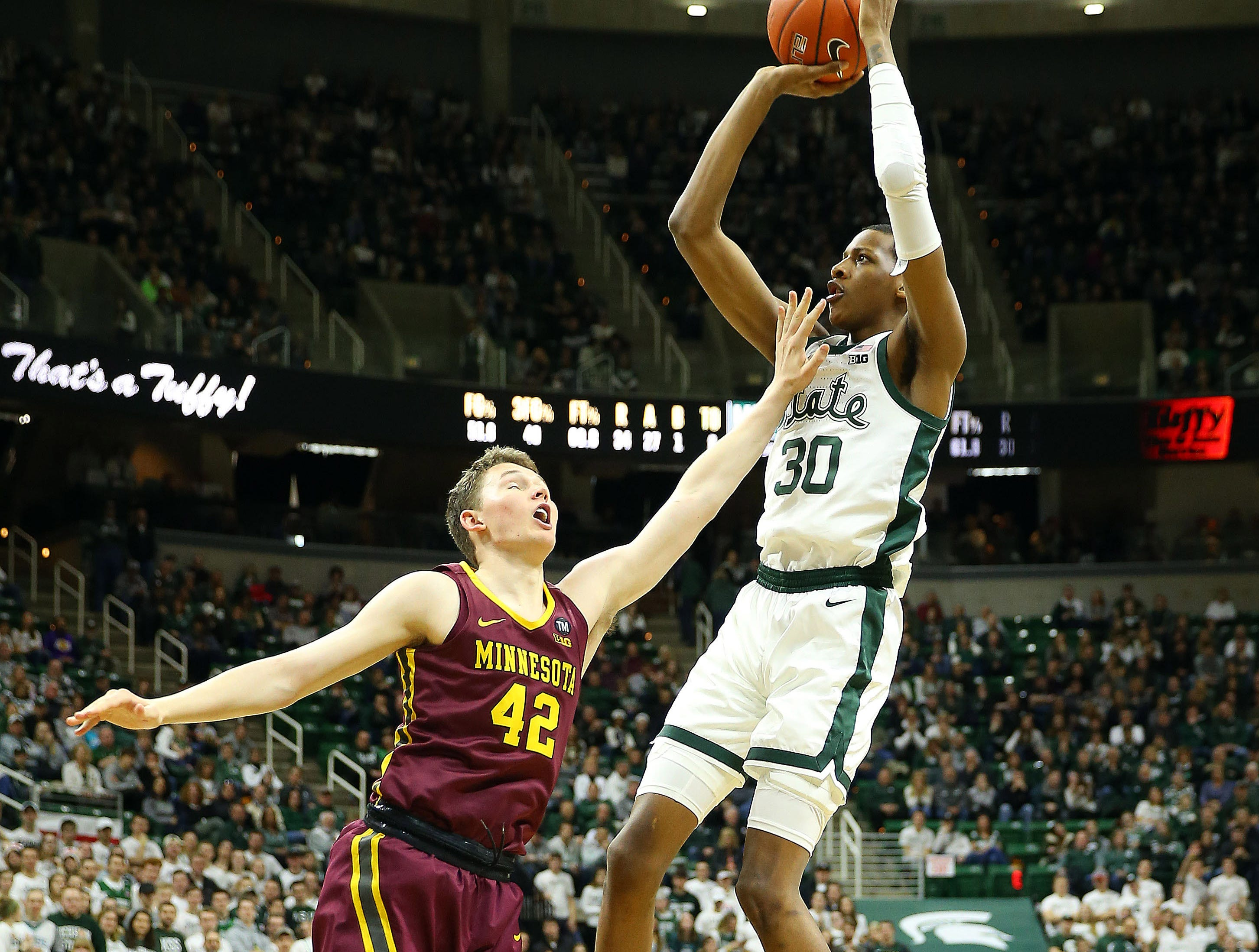 Feb 9, 2019; East Lansing, MI, USA; Michigan State Spartans forward Marcus Bingham Jr. (30) shoots the ball over Minnesota Golden Gophers forward Michael Hurt (42) during the second half at the Breslin Center. Mandatory Credit: Mike Carter-USA TODAY Sports