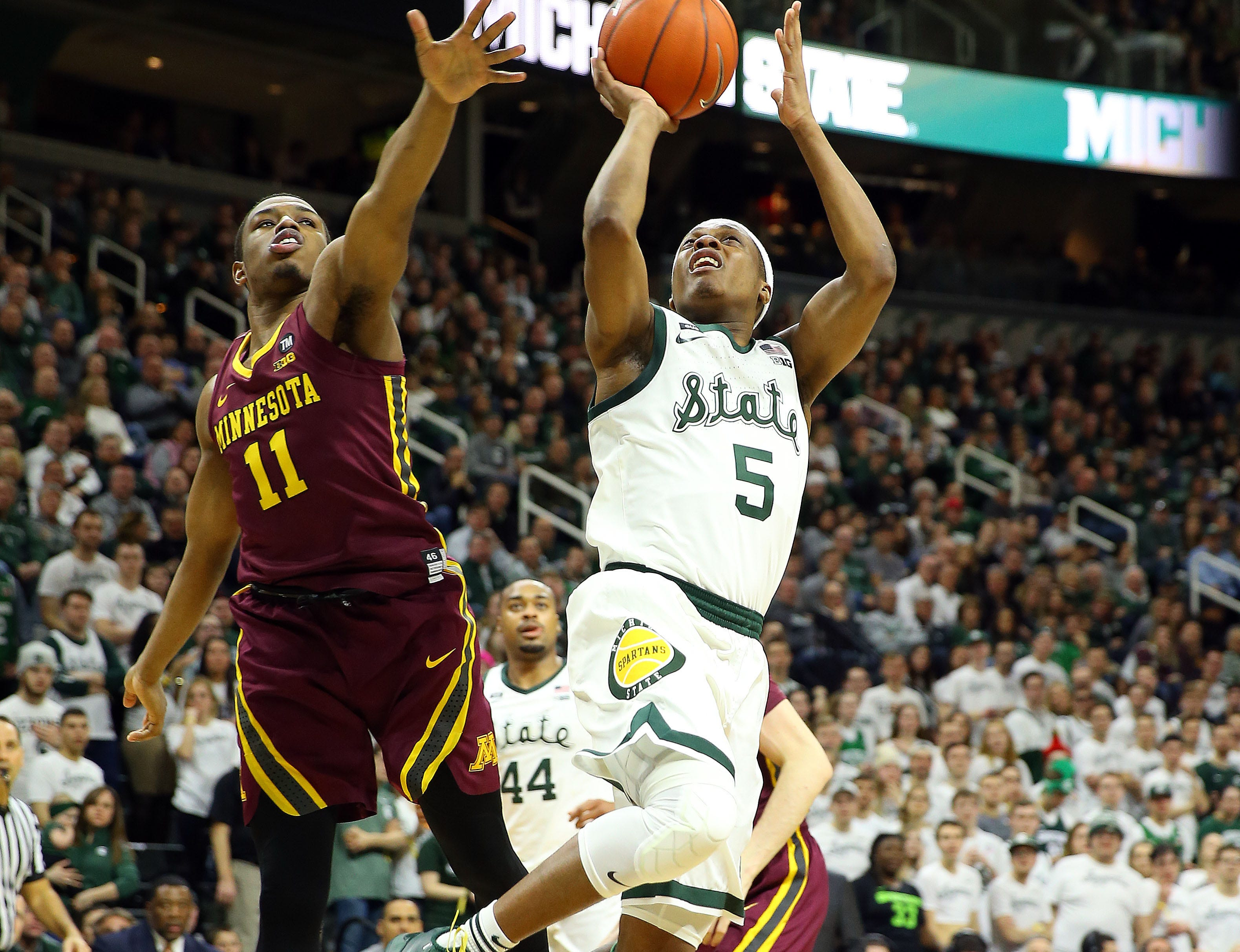 Feb 9, 2019; East Lansing, MI, USA; Michigan State Spartans guard Cassius Winston (5) shoots against Minnesota Golden Gophers guard Isaiah Washington (11) during the second half at the Breslin Center. Mandatory Credit: Mike Carter-USA TODAY Sports