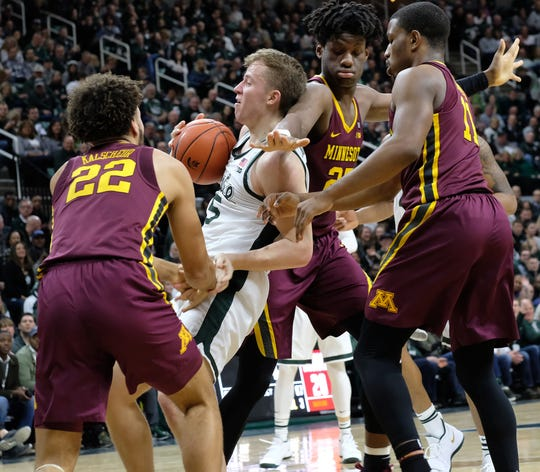MSU's Thomas Kithier (15) comes up with the ball against three Minnesota players Saturday, Feb. 9, 2019.