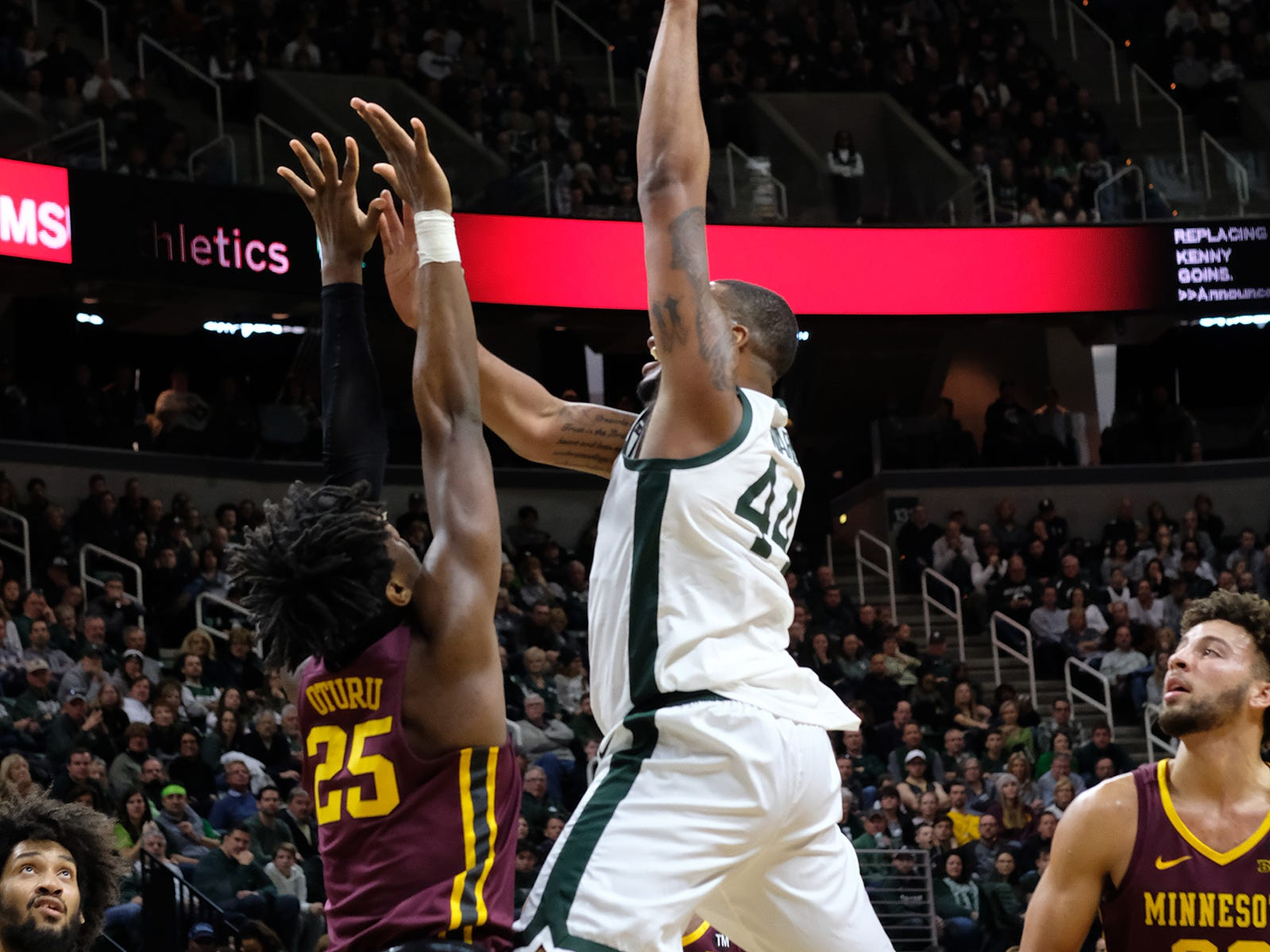 MSU's Nick Ward shoots against Minnesota's Daniel Oturu in a Big Ten matchup Saturday, Feb. 9, 2019.