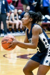 East Lansing's Sanaya Gregory shoots a 3-pointer during the second quarter on Friday, Feb. 8, 2019, at Okemos High School.