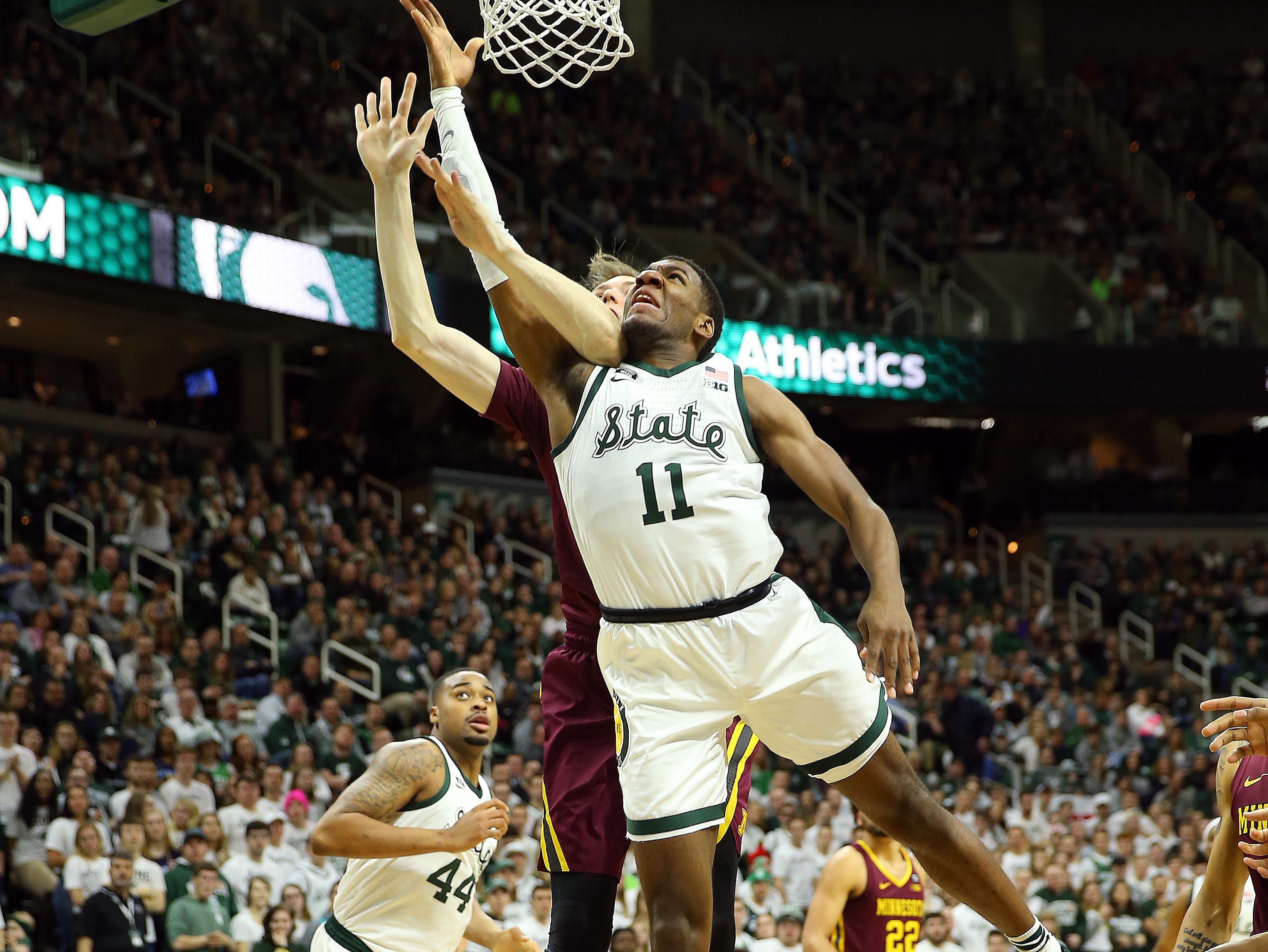 Feb 9, 2019; East Lansing, MI, USA; Michigan State Spartans forward Aaron Henry (11) lays the ball up against the Minnesota Golden Gophers during the second half at the Breslin Center. Mandatory Credit: Mike Carter-USA TODAY Sports