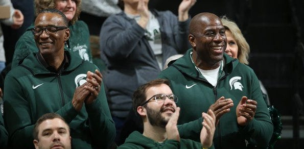 Magic Johnson applauds the Michigan State men's basketball team during its game against Minnesota on Saturday, Feb. 9, 2019.