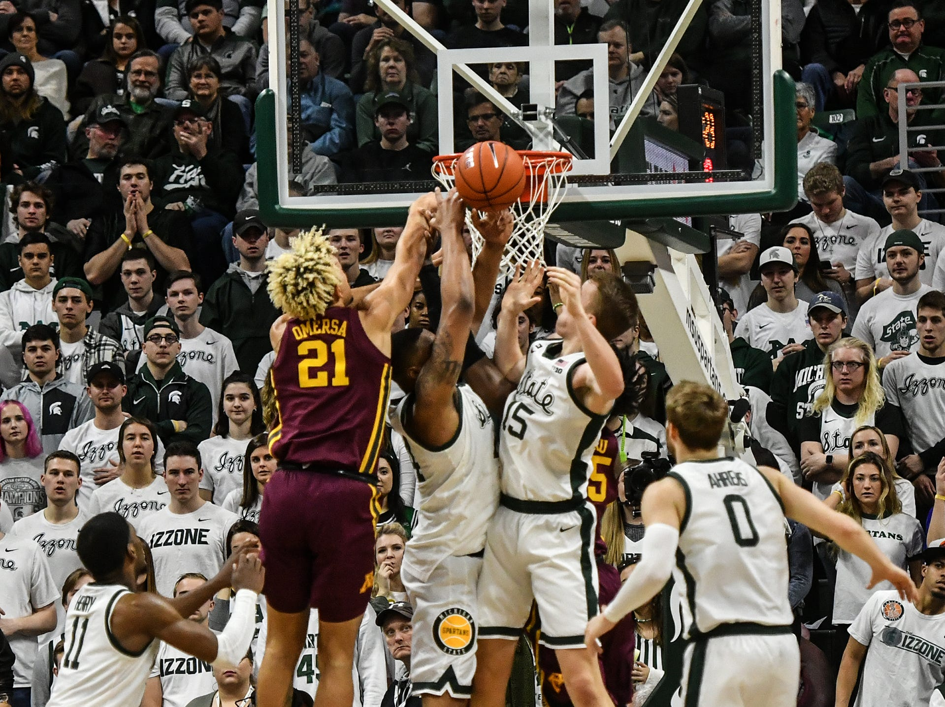 MSU and Minnesota fight for a rebound in a Big Ten match-up Saturday, Feb. 9, 2019. MSU won 79-55.