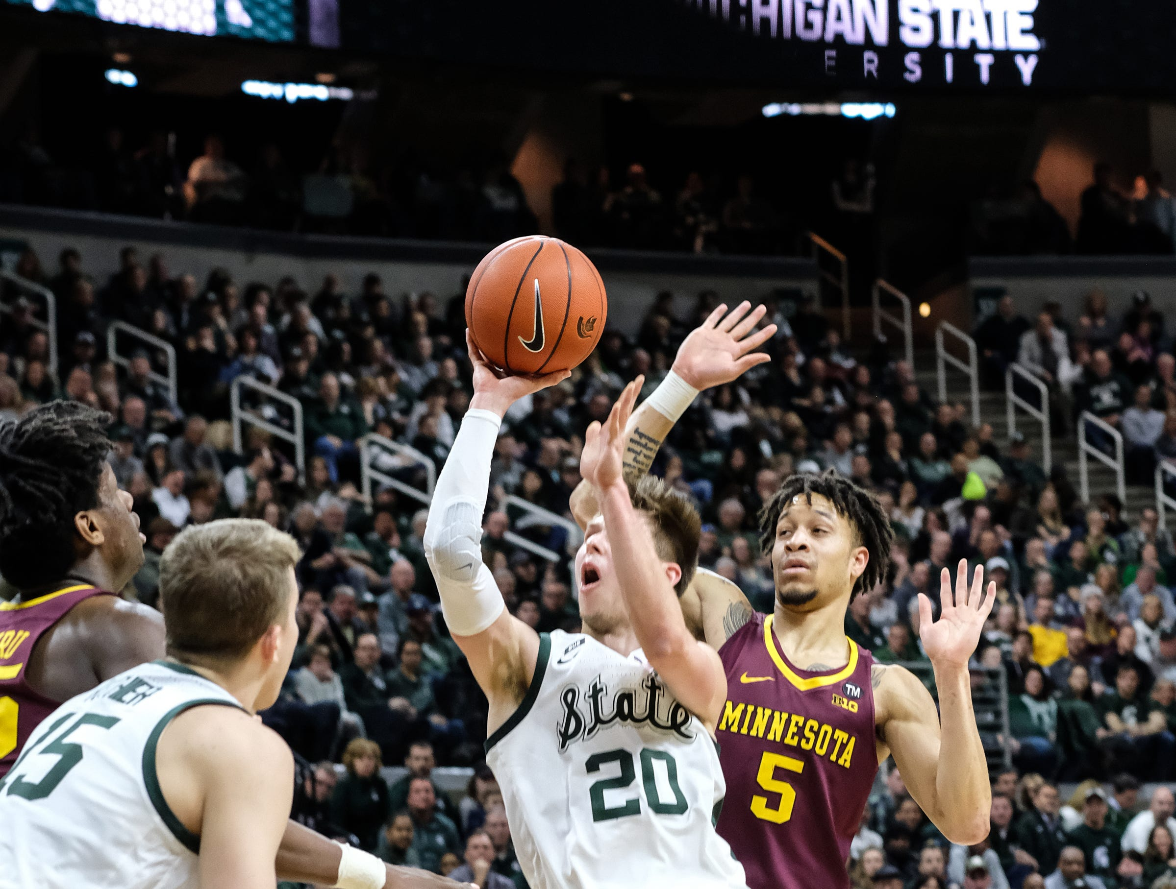 MSU's Matt McQuaid (20) shoots against Minnesota Saturday, Feb. 9, 2019. MSU won 79-55.