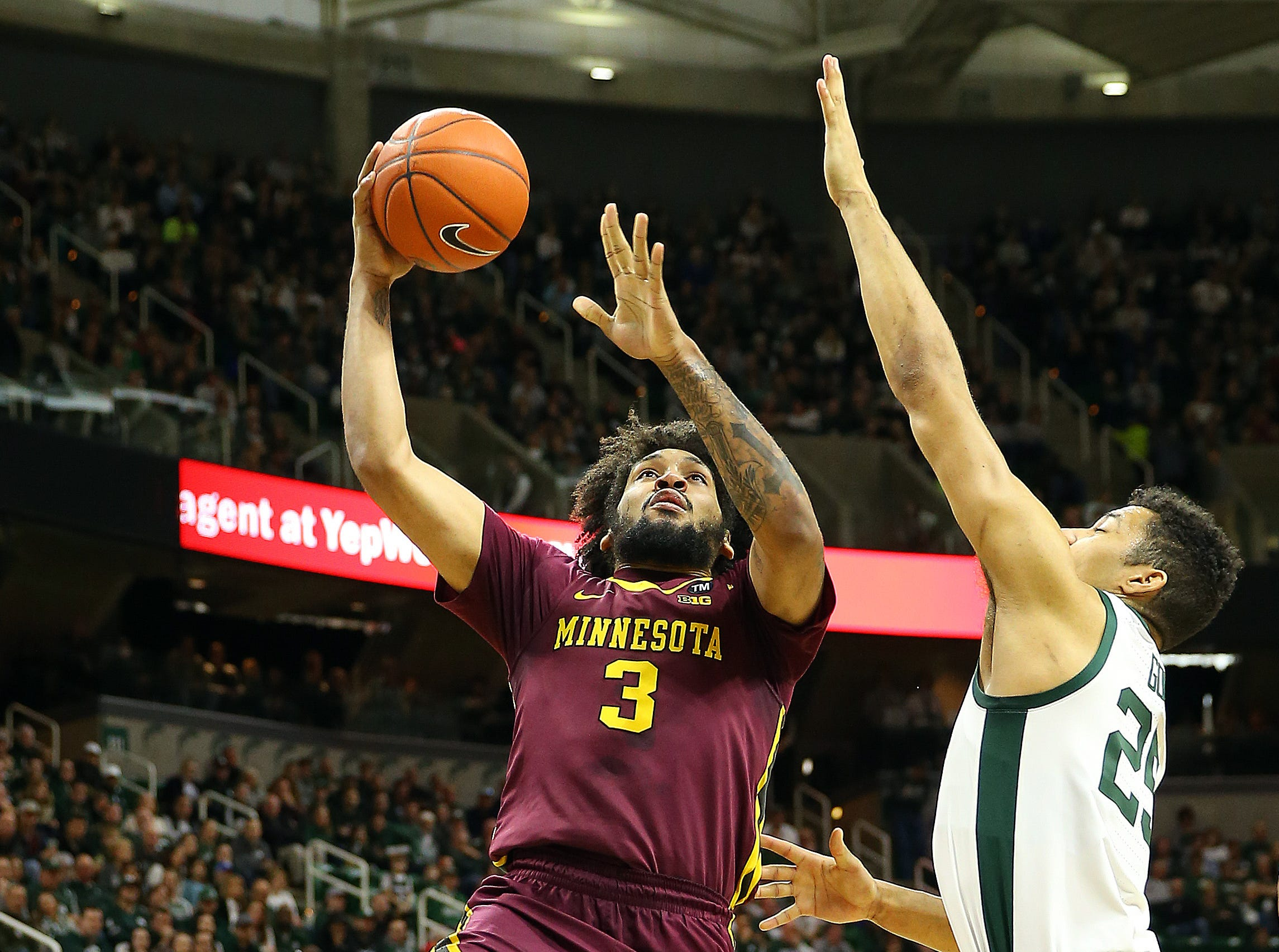 Feb 9, 2019; East Lansing, MI, USA; Minnesota Golden Gophers forward Jordan Murphy (3) drives to the basket against Michigan State Spartans forward Kenny Goins (25) during the first half at the Breslin Center. Mandatory Credit: Mike Carter-USA TODAY Sports