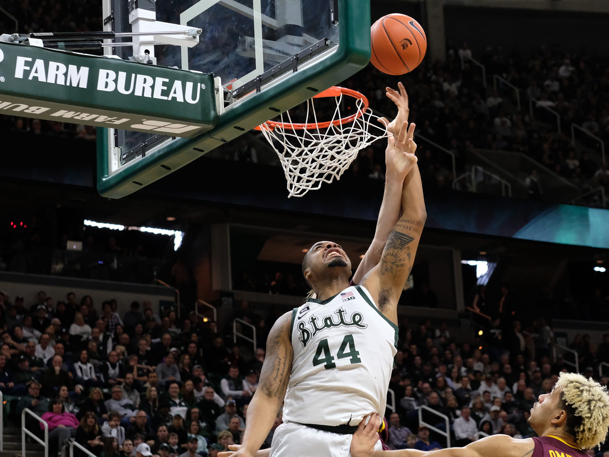 MSU's Nick Ward (44) scores under the basket against Minnesota Saturday, Feb. 9, 2019. MSU won 79-55.
