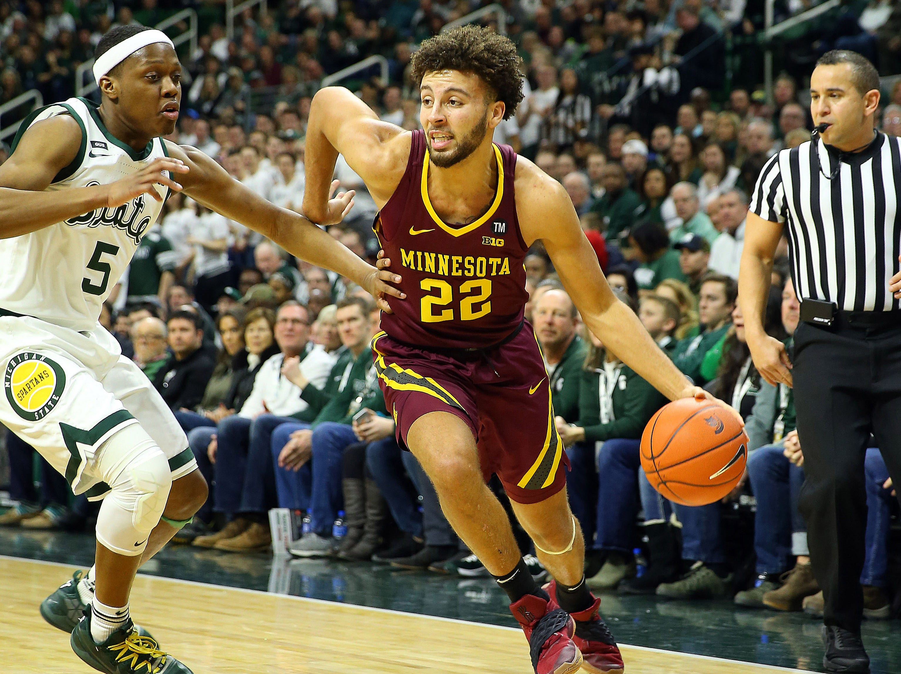 Feb 9, 2019; East Lansing, MI, USA; Minnesota Golden Gophers guard Gabe Kalscheur (22) drives to the basket against Michigan State Spartans guard Cassius Winston (5) during the first half at the Breslin Center. Mandatory Credit: Mike Carter-USA TODAY Sports