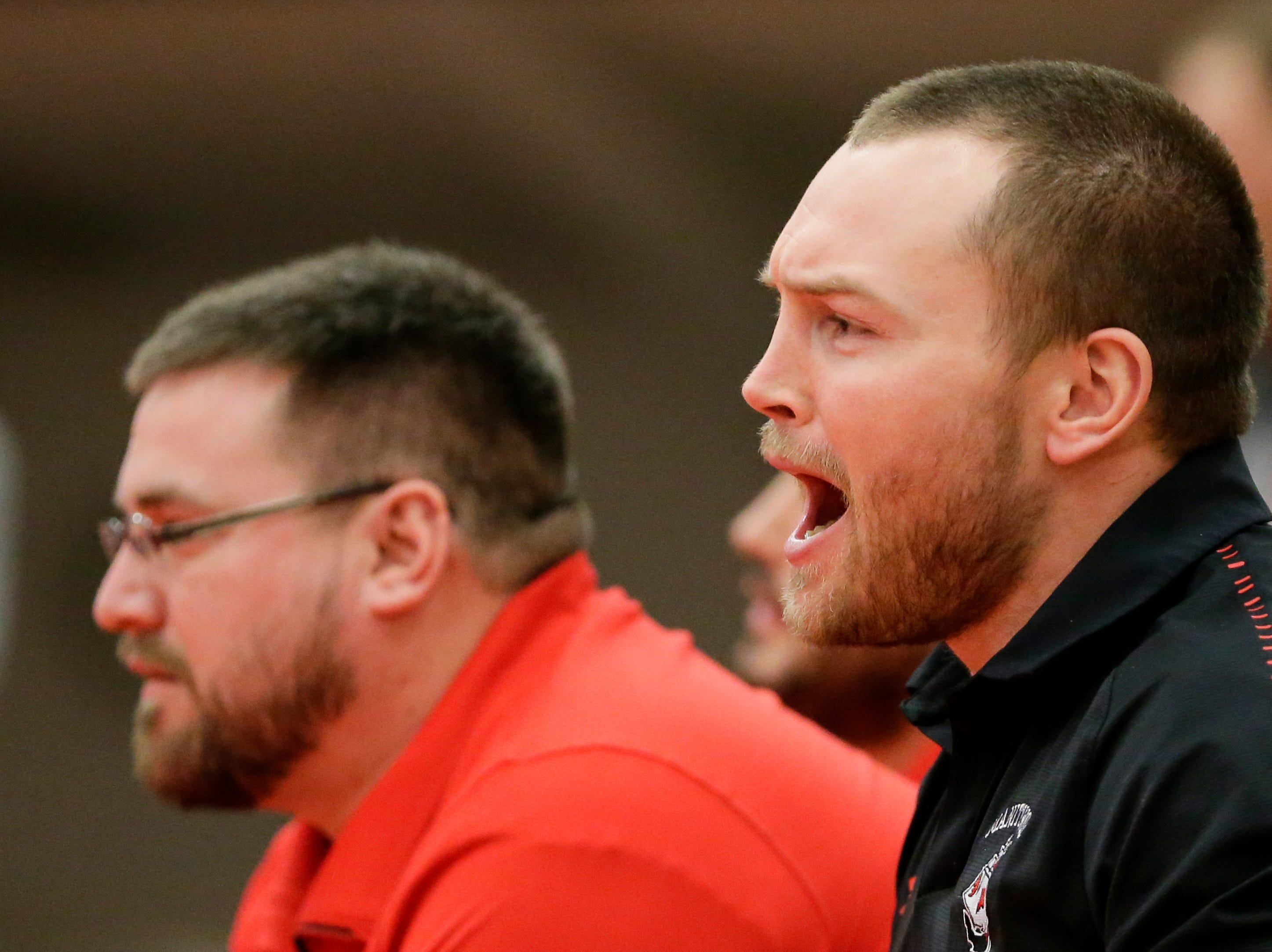 Manitowoc Lincoln coaches talk to Jacob DeBruin as he wrestles in the170 weight class during the WIAA D1 Regionals at Manitowoc Lincoln High School Saturday, February 9, 2019, in Manitowoc, Wis. Joshua Clark/USA TODAY NETWORK-Wisconsin