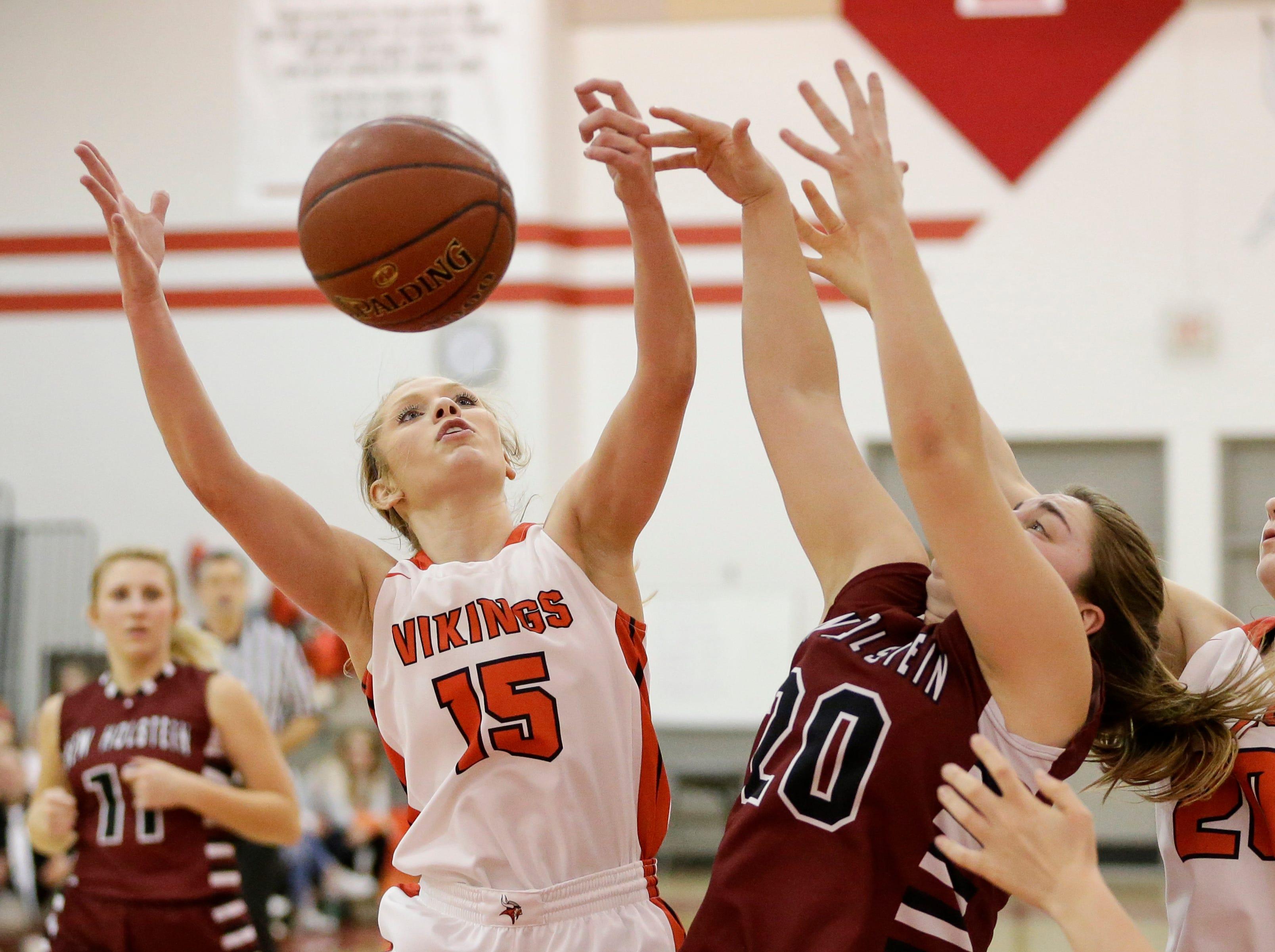 Valders' Jenna Evenson (15) battles New Holstein's Mackenzie Doherty (20) for a rebound at Valders High School Friday, February 8, 2019, in Valders, Wis. Joshua Clark/USA TODAY NETWORK-Wisconsin